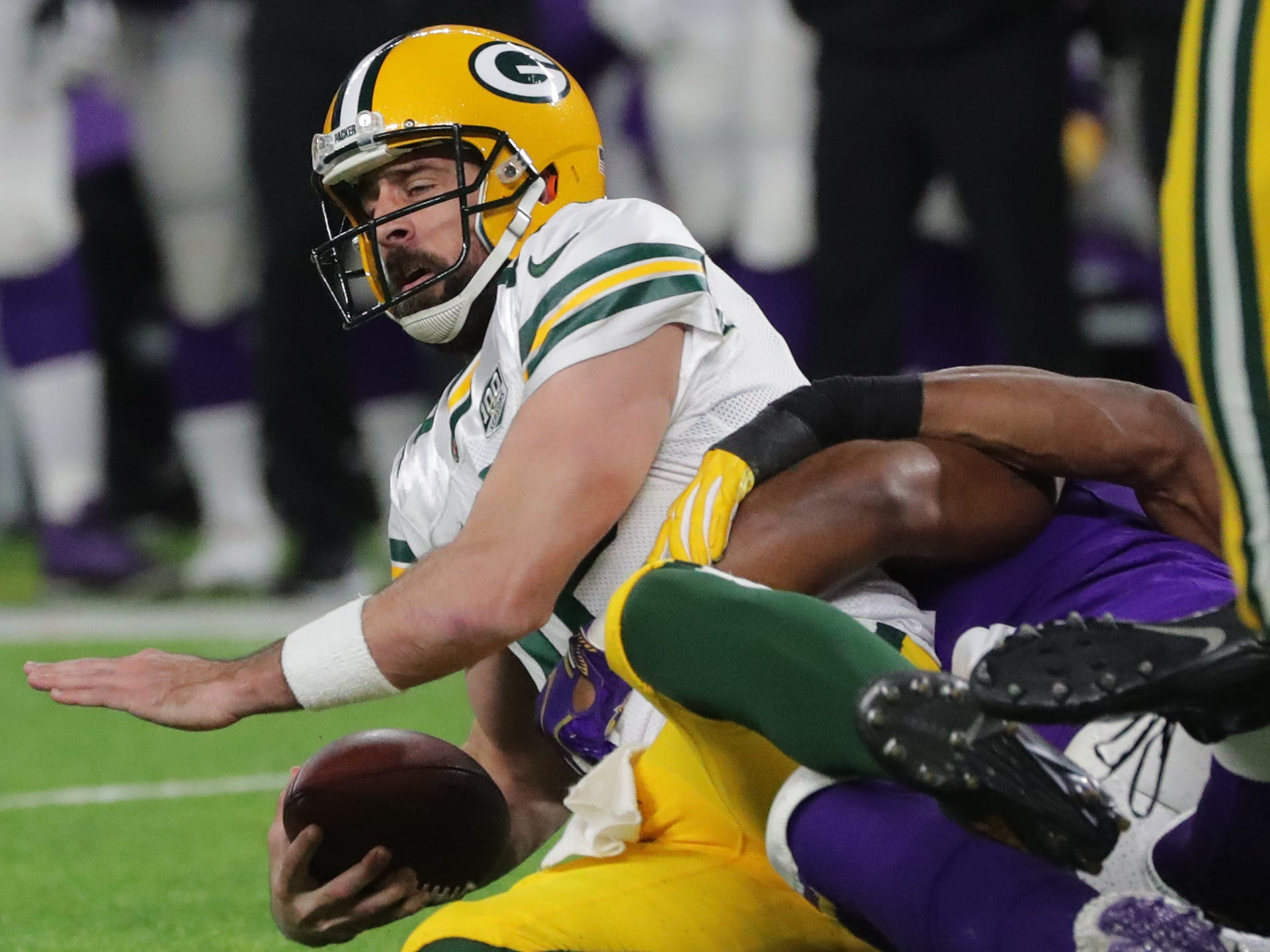 Green Bay Packers quarterback Aaron Rodgers (12) is sacked during the second quarter of their game against the Minnesota Vikings Sunday, November 25, 2018 at U.S. Bank Stadium in Minneapolis, Minn.