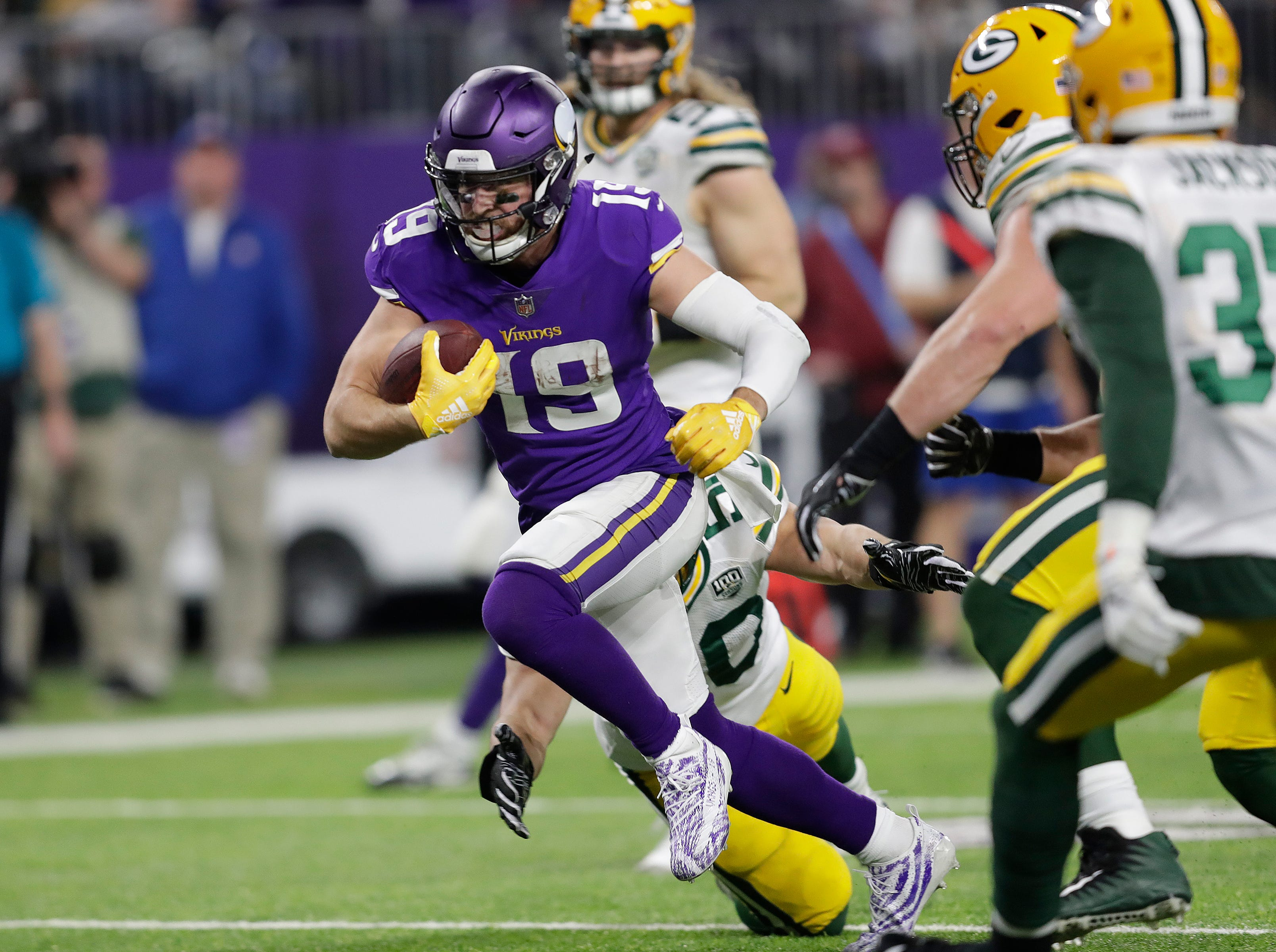 Minnesota Vikings wide receiver Adam Thielen (19) scores a touchdown in the thrid quarter against the Green Bay Packers during their football game Sunday, November 25, 2018, at U.S. Bank Stadium in Minneapolis, Minn. 