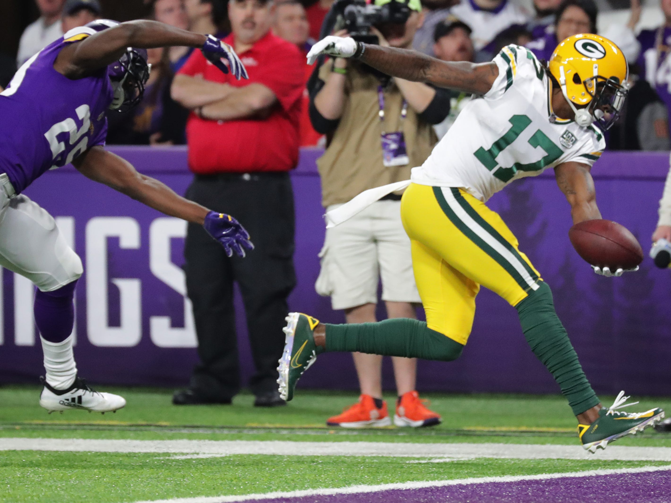 Green Bay Packers wide receiver Davante Adams (17) scores a touchdown on a 15-yard reception while being covered by Minnesota Vikings cornerback Xavier Rhodes (29) during the second quarter of their game Sunday, November 25, 2018 at U.S. Bank Stadium in Minneapolis, Minn.