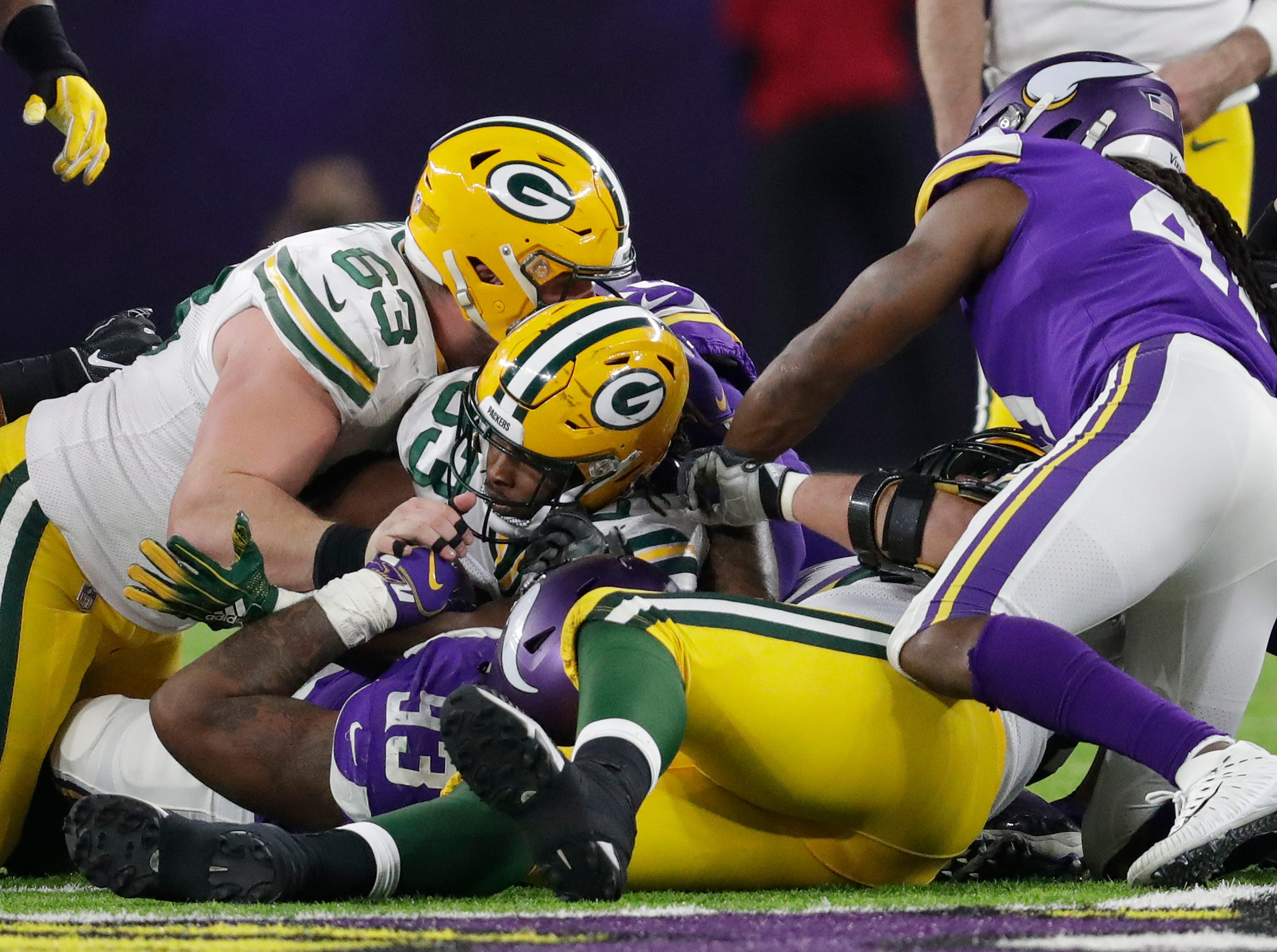 Green Bay Packers running back Aaron Jones (33) can't convert a fourth down in the fourth quarter against the Minnesota Vikings during their football game Sunday, November 25, 2018, at U.S. Bank Stadium in Minneapolis, Minn. 