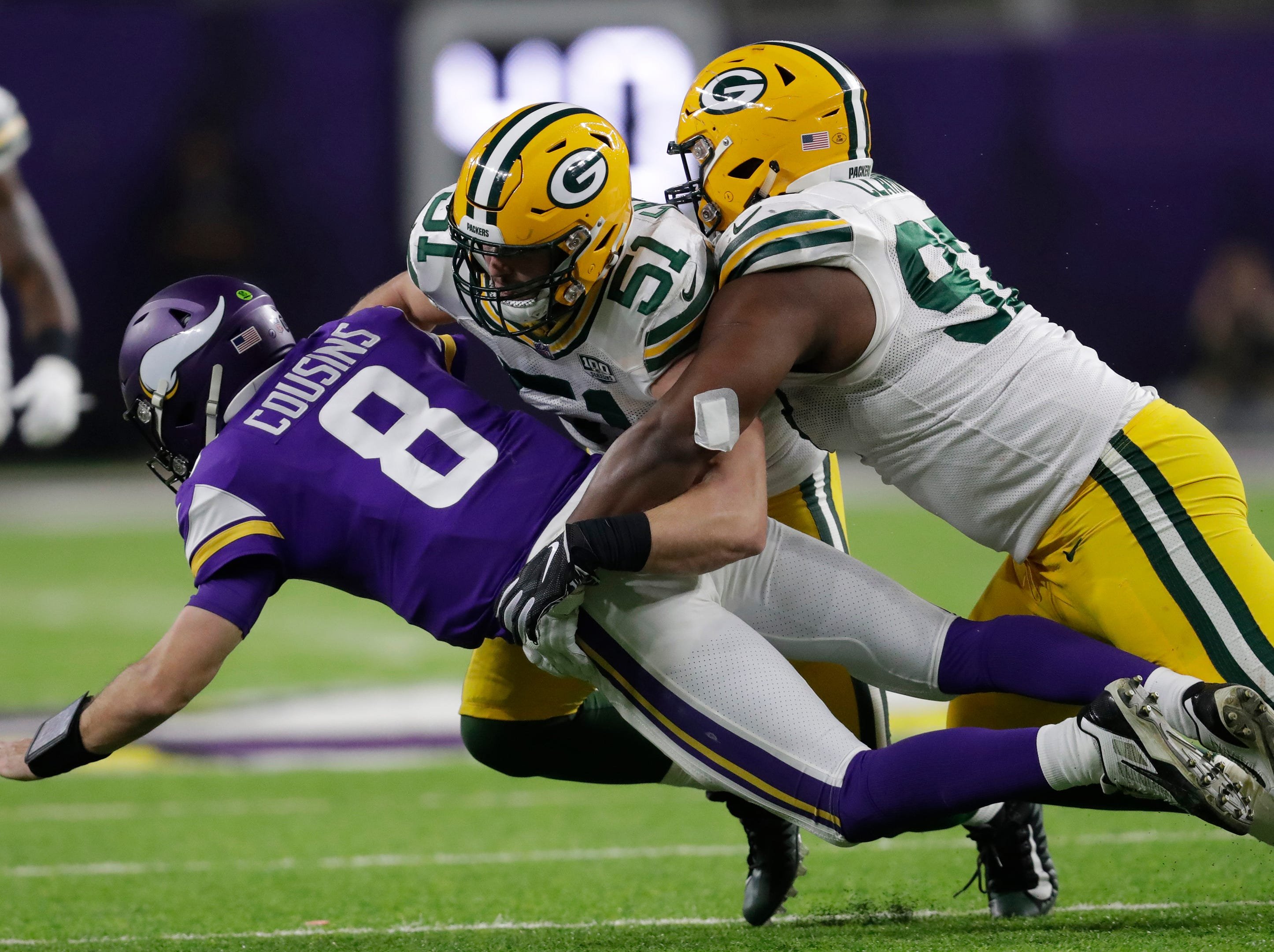 Green Bay Packers linebacker Kyler Fackrell (51) tackles Minnesota Vikings quarterback Kirk Cousins (8) in the third quarter during their football game Sunday, November 25, 2018, at U.S. Bank Stadium in Minneapolis, Minn. 