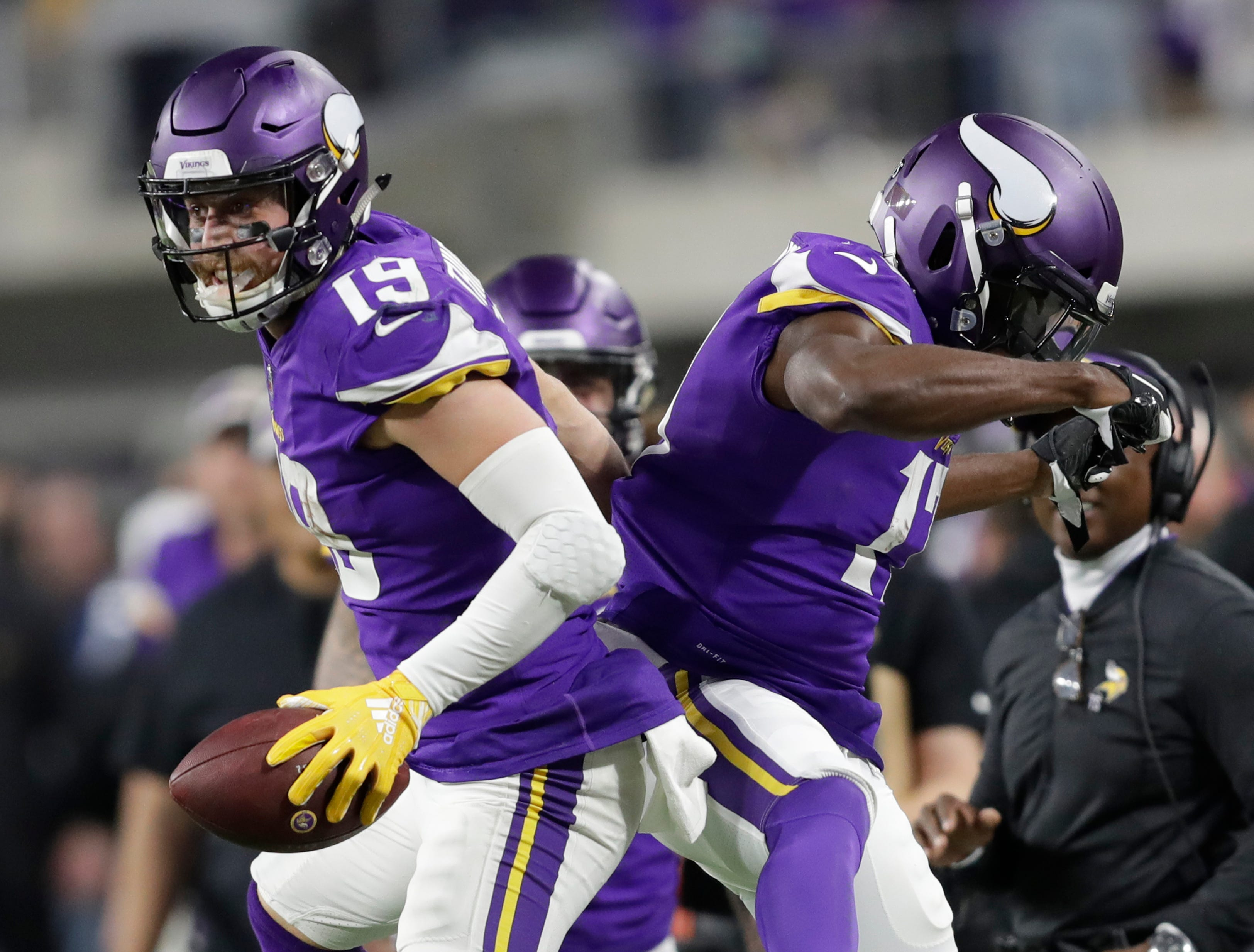 Minnesota Vikings wide receiver Adam Thielen (19) celebrates scoring a touchdown in the third quarter with wide receiver Aldrick Robinson (17) against the Green Bay Packers during their football game Sunday, November 25, 2018, at U.S. Bank Stadium in Minneapolis, Minn. 