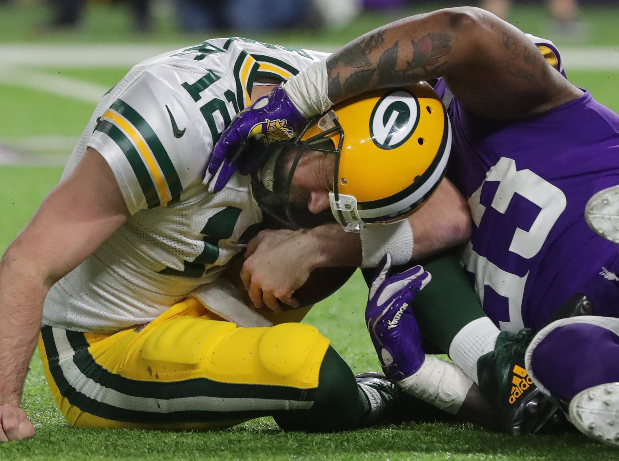 Green Bay Packers quarterback Aaron Rodgers (12) is sacked by Minnesota Vikings defensive tackle Sheldon Richardson (93) during the fourth quarter of their game Sunday, November 25, 2018 at U.S. Bank Stadium in Minneapolis, Minn. The Minnesota Vikings beat the Green Bay Packers 24-17.