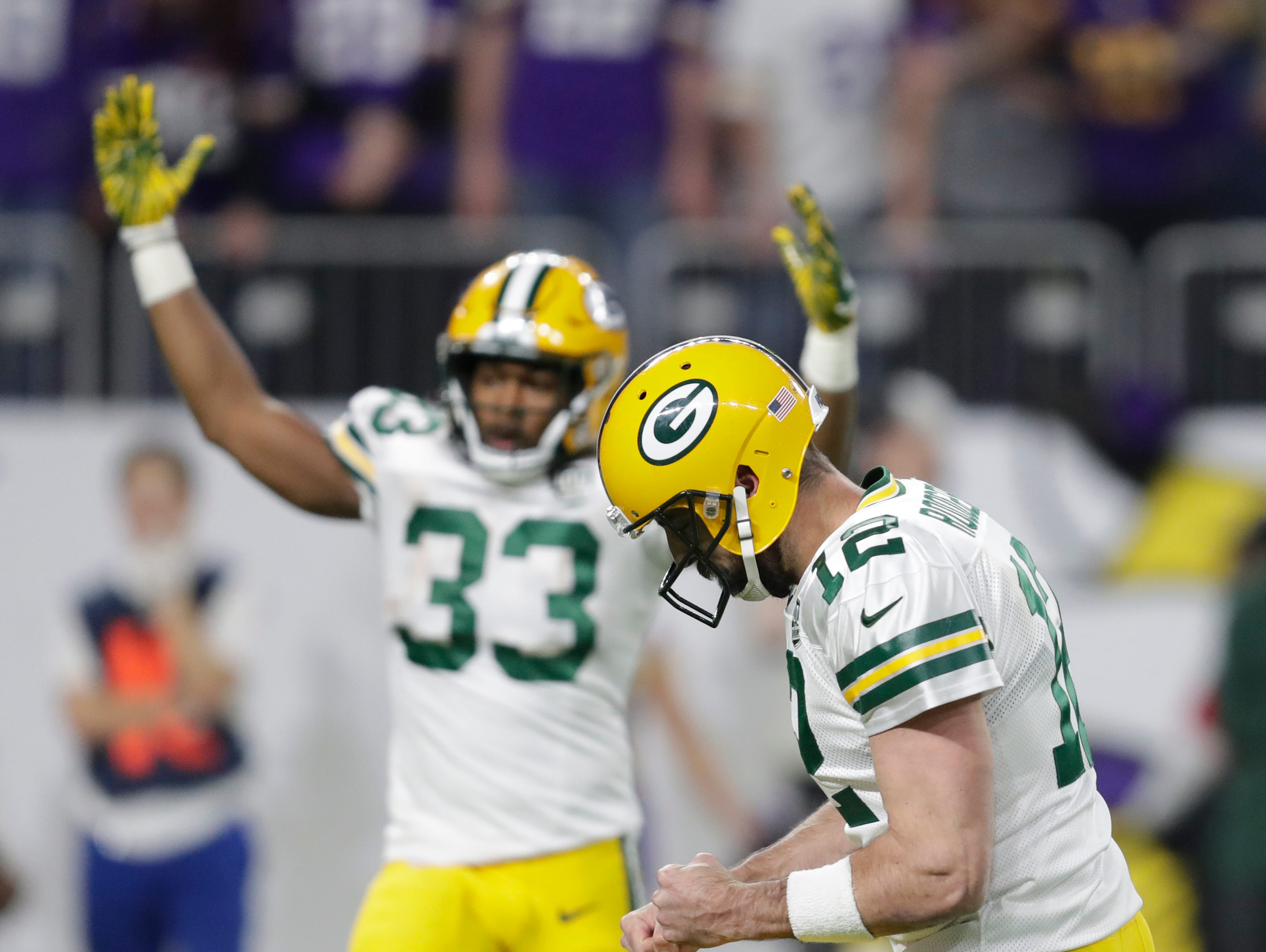 Green Bay Packers quarterback Aaron Rodgers (12) and running back Aaron Jones (33) celebrate a first quarter touchdown pass against the Vikings during their football game Sunday, November 25, 2018, at U.S. Bank Stadium in Minneapolis, Minn. 