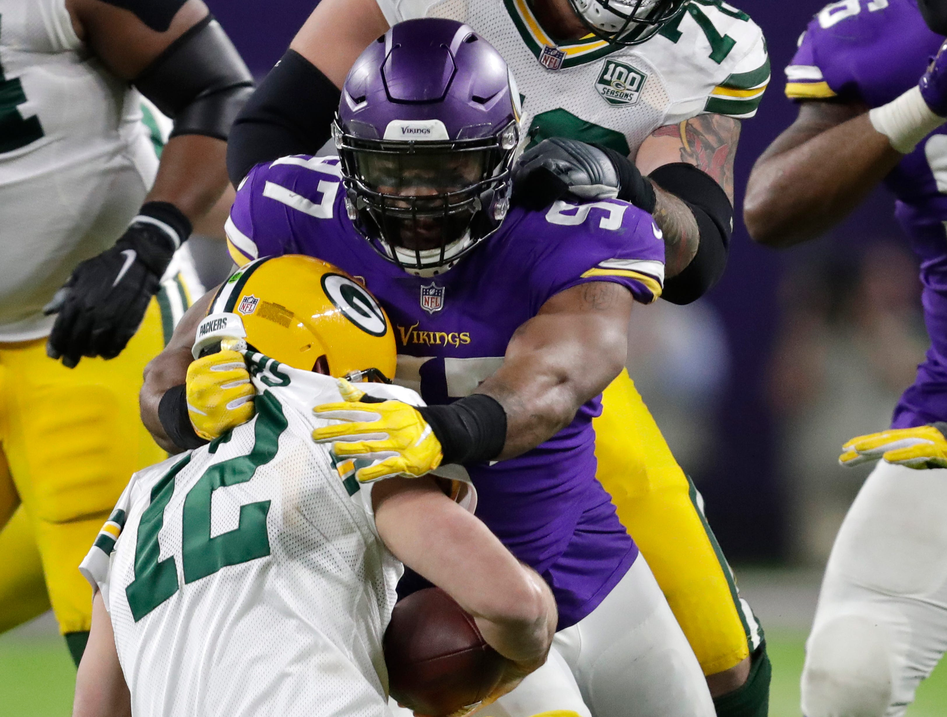 Minnesota Vikings defensive end Everson Griffen (97) sacks Green Bay Packers quarterback Aaron Rodgers (12) in the fourth quarter during their football game Sunday, November 25, 2018, at U.S. Bank Stadium in Minneapolis, Minn. 