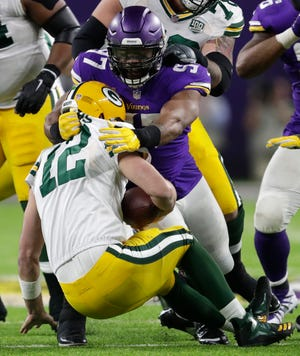 Minnesota Vikings defensive end Everson Griffen (97) sacks Green Bay Packers quarterback Aaron Rodgers (12) in the fourth quarter during their football game Sunday, November 25, 2018, at U.S. Bank Stadium in Minneapolis, Minn. Dan Powers/USA TODAY NETWORK-Wisconsin