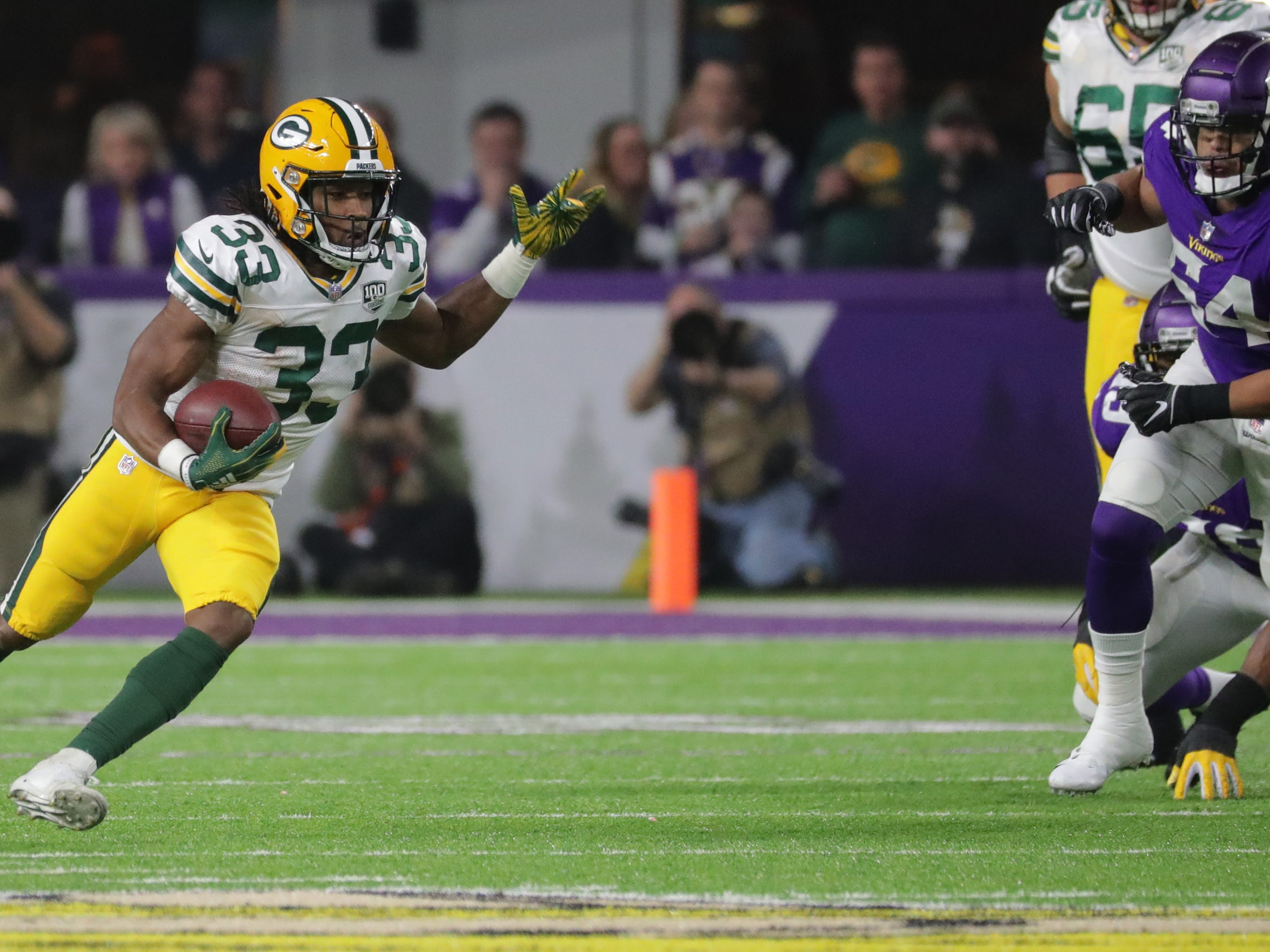 Green Bay Packers running back Aaron Jones (33) find plenty of running room while picking up a first down during the second quarter of their game against the Minnesota Vikings Sunday, November 25, 2018 at U.S. Bank Stadium in Minneapolis, Minn.