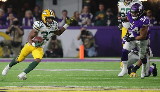 Green Bay Packers running back Aaron Jones (33) find plenty of running room while picking up a first down during the second quarter of their game against the Minnesota Vikings Sunday, November 25, 2018 at U.S. Bank Stadium in Minneapolis, Minn.MARK HOFFMAN/MHOFFMAN@JOURNALSENTINEL.COM