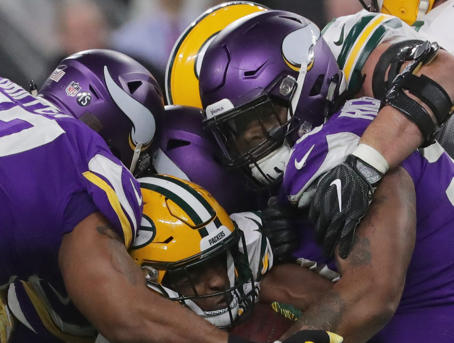 Green Bay Packers running back Aaron Jones (33) is smothered by the Minnesotas Vikings defense during the third quarter of their game Sunday, November 25, 2018 at U.S. Bank Stadium in Minneapolis, Minn. The Minnesota Vikings beat the Green Bay Packers 24-17.