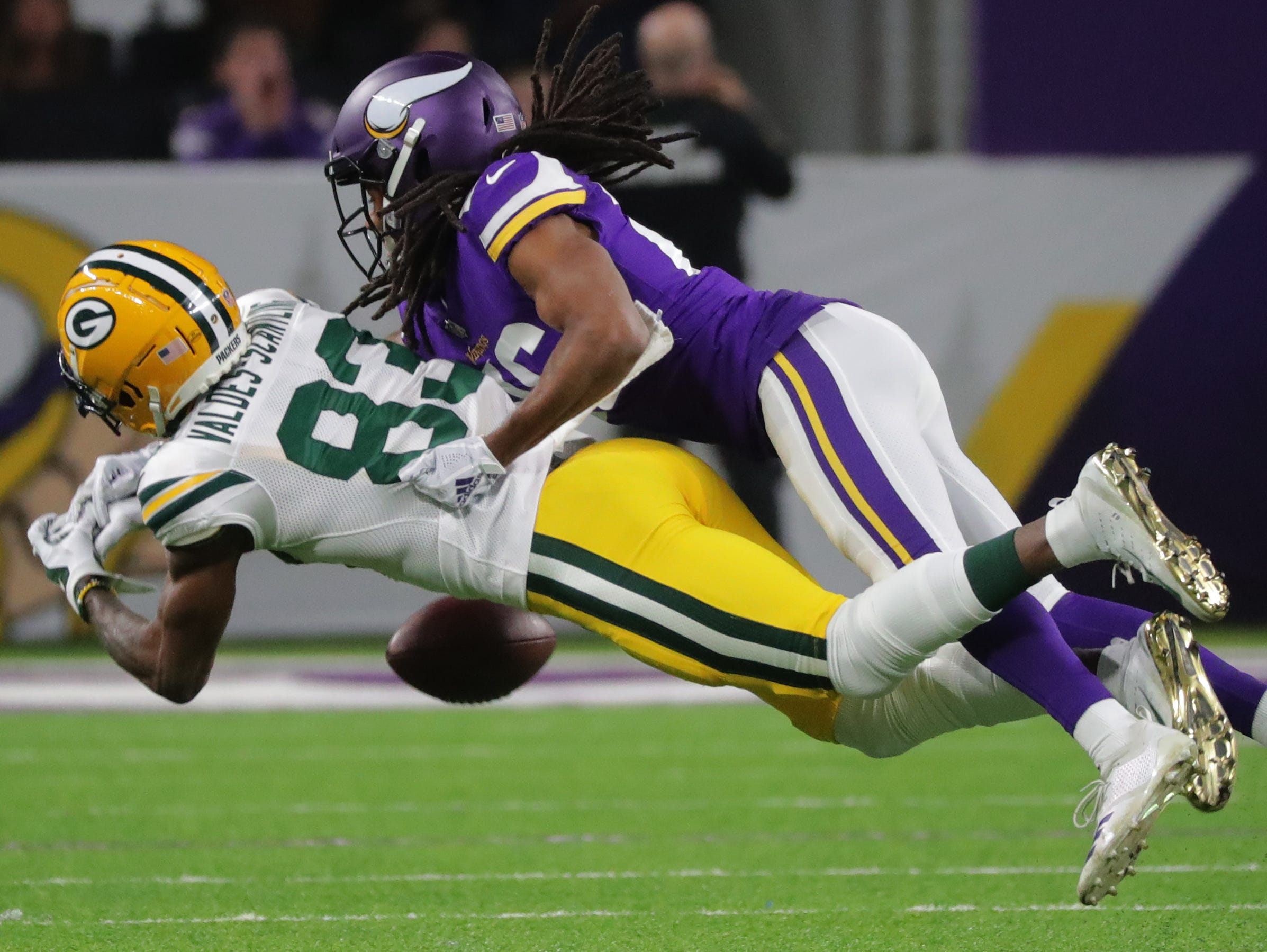 Green Bay Packers wide receiver Marquez Valdes-Scantling (83) is unable to catch a ball while being covered by Minnesota Vikings cornerback Trae Waynes (26) during the first quarter of their game against the Minnesota Vikings Sunday, November 25, 2018 at U.S. Bank Stadium in Minneapolis, Minn.