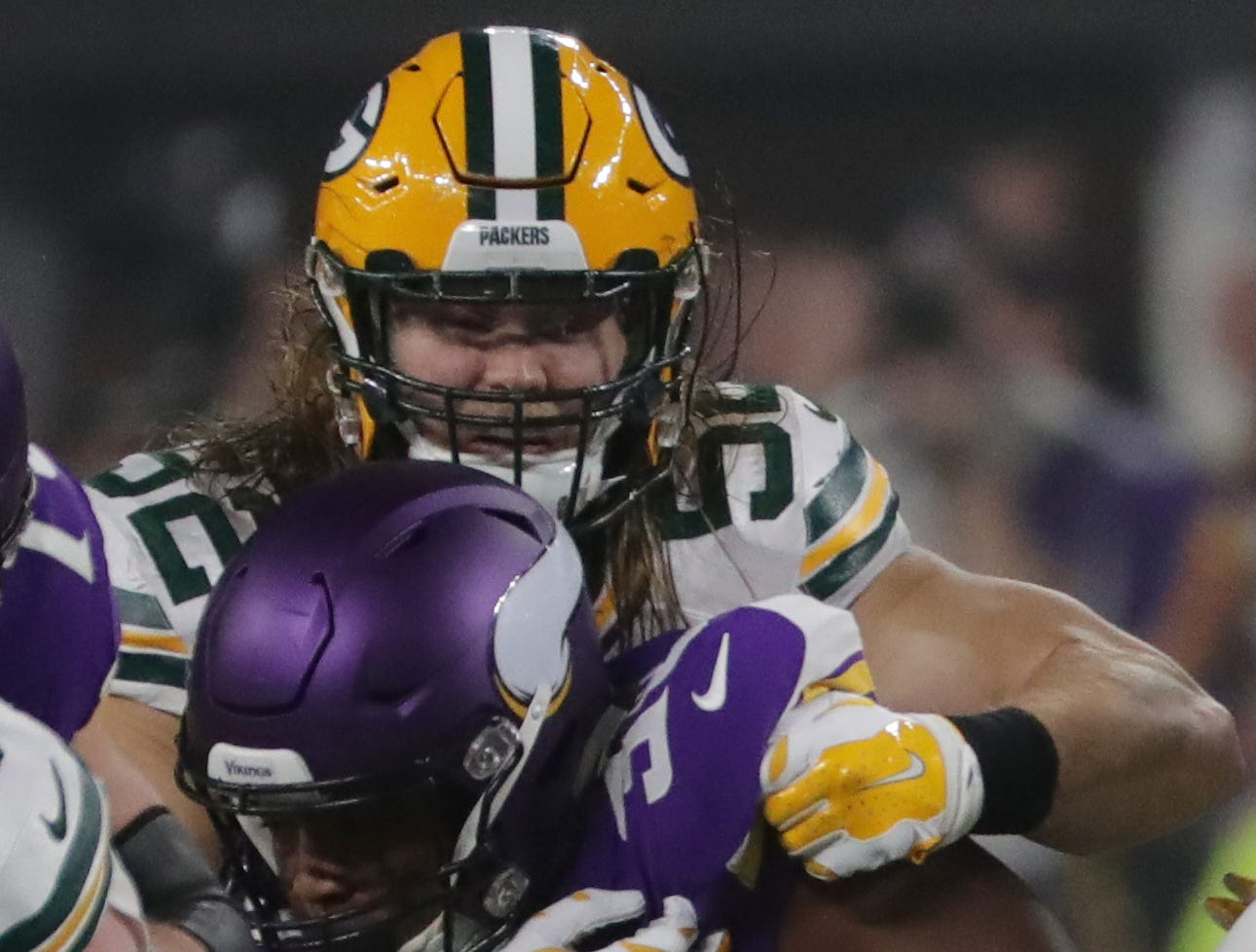 Green Bay Packers outside linebacker Clay Matthews (52) wraps up Minnesota Vikings fullback C.J. Ham (30) during the second quarter of their game Sunday, November 25, 2018 at U.S. Bank Stadium in Minneapolis, Minn.