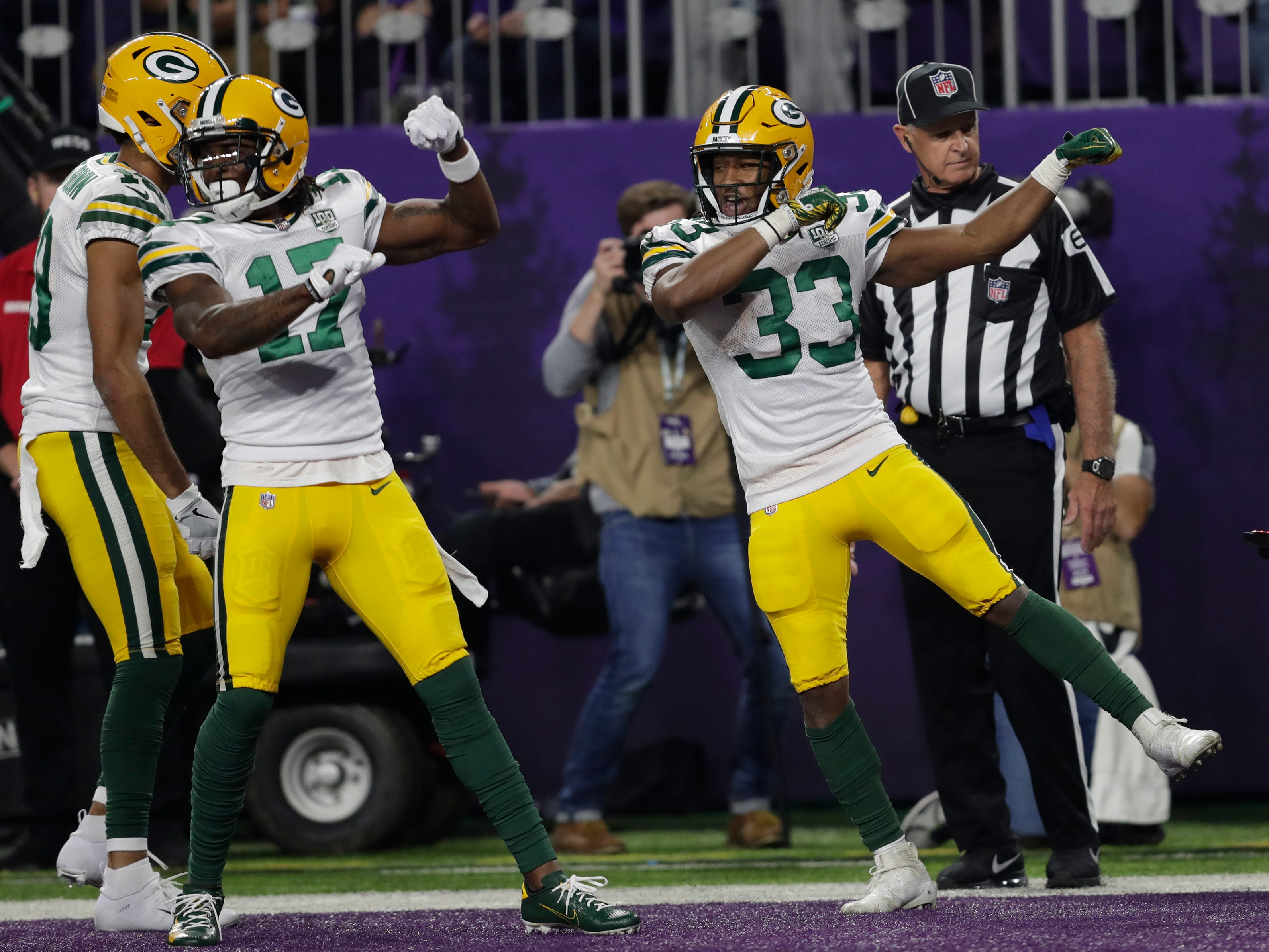 Green Bay Packers running back Aaron Jones (33) celebrates his touchdown run with wide receiver Davante Adams (17) in the second quarter during their football game Sunday, November 25, 2018, at U.S. Bank Stadium in Minneapolis, Minn. 
