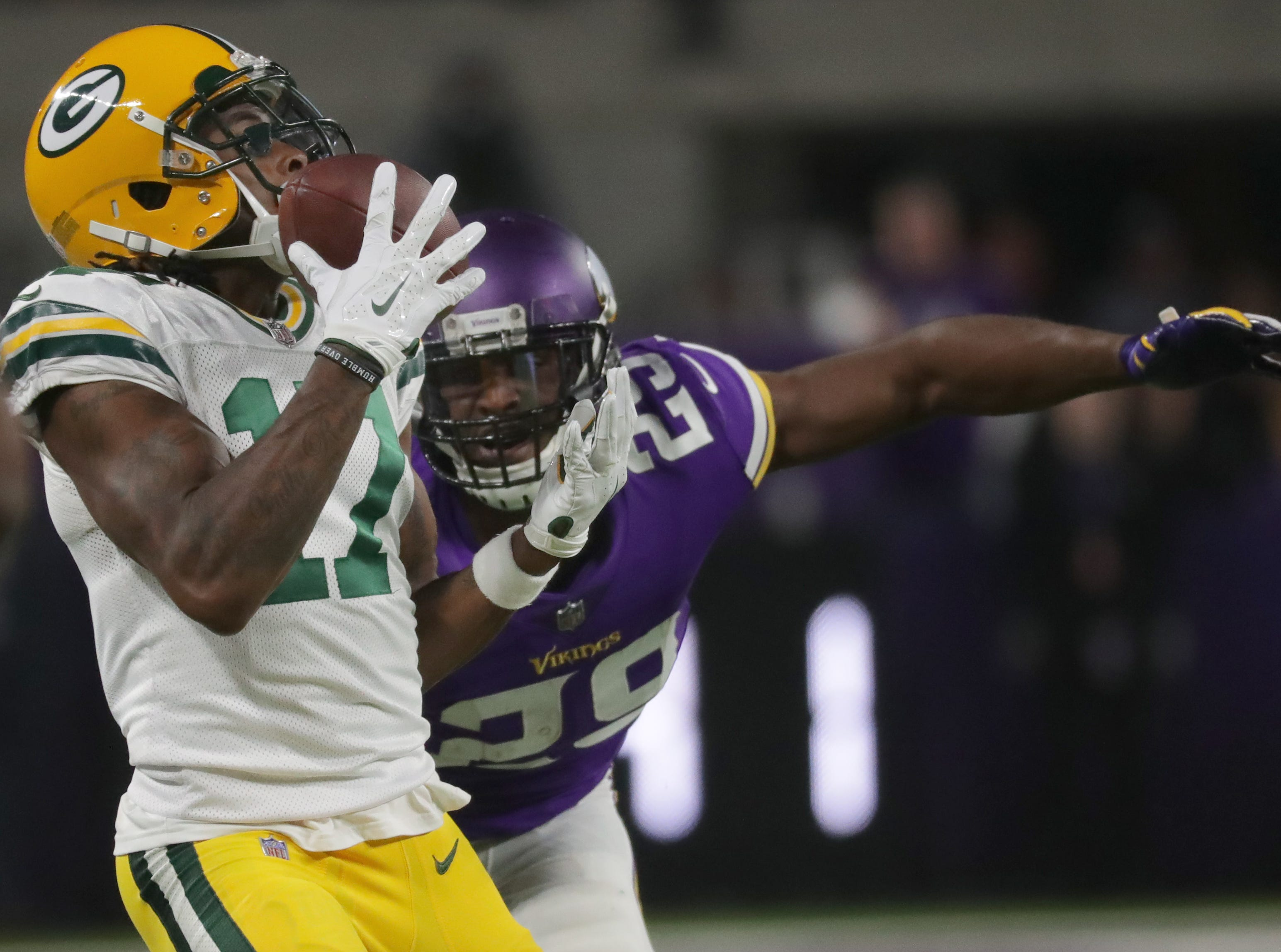 Green Bay Packers wide receiver Davante Adams (17) reels in long reception while being covered by Minnesota Vikings cornerback Xavier Rhodes (29) during the fourth  quarter of their game Sunday, November 25, 2018 at U.S. Bank Stadium in Minneapolis, Minn. The Minnesota Vikings beat the Green Bay Packers 24-17.