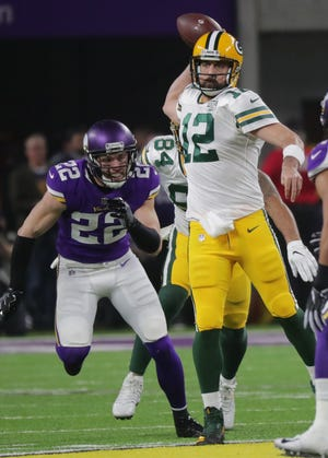 Green Bay Packers quarterback Aaron Rodgers (12)= rifles a pass during the second quarter of their game against the Minnesota Vikings Sunday, November 25, 2018 at U.S. Bank Stadium in Minneapolis, Minn.