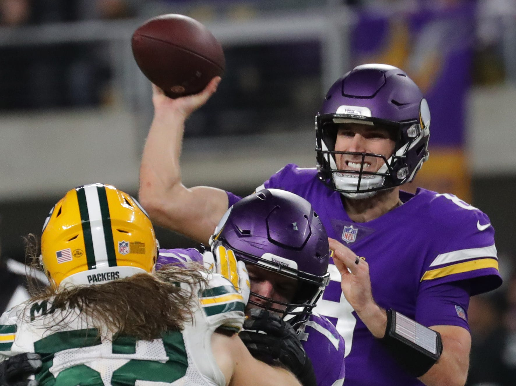 Minnesota Vikings quarterback Kirk Cousins (8) throws pass over Green Bay Packers outside linebacker Clay Matthews (52) during the third quarter of their game Sunday, November 25, 2018 at U.S. Bank Stadium in Minneapolis, Minn. The Minnesota Vikings beat the Green Bay Packers 24-17.