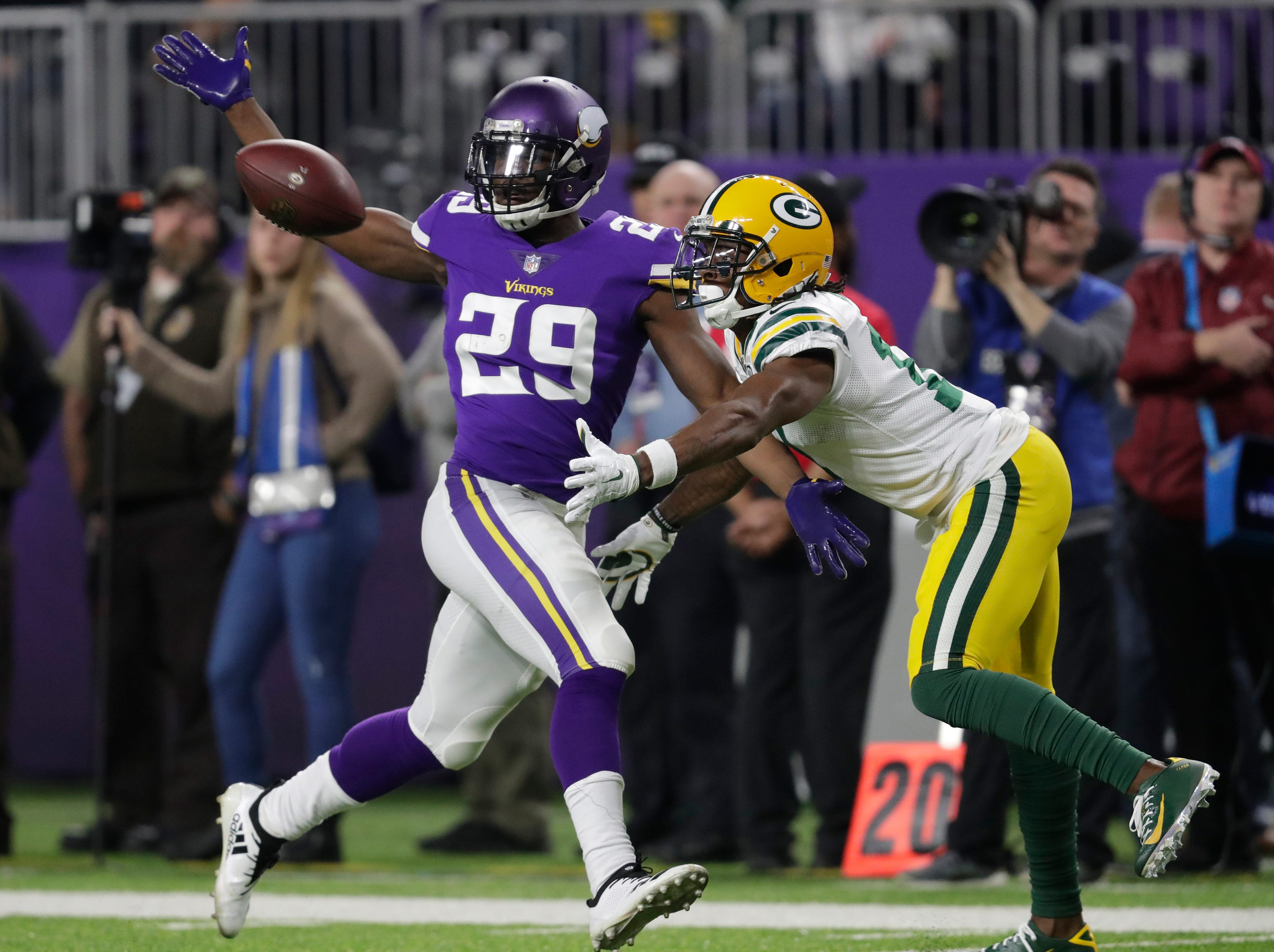 Green Bay Packers wide receiver Davante Adams (17) can't make a catch against Minnesota Vikings cornerback Xavier Rhodes (29) during their football game Sunday, November 25, 2018, at U.S. Bank Stadium in Minneapolis, Minn. 