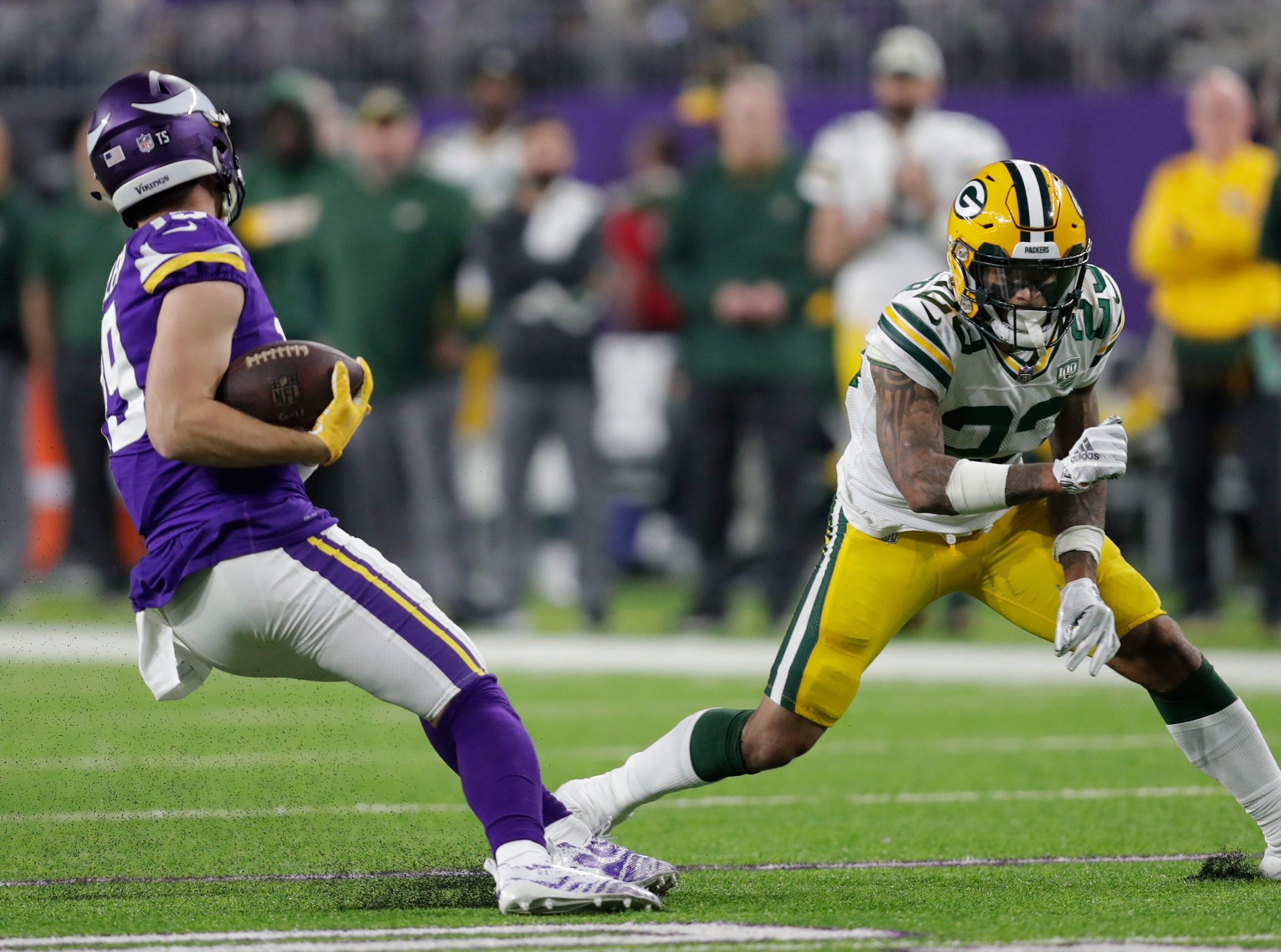 Green Bay Packers cornerback Jaire Alexander (23) misses a tackle against Minnesota Vikings wide receiver Adam Thielen (19) in the second quarter during their football game Sunday, November 25, 2018, at U.S. Bank Stadium in Minneapolis, Minn. 
