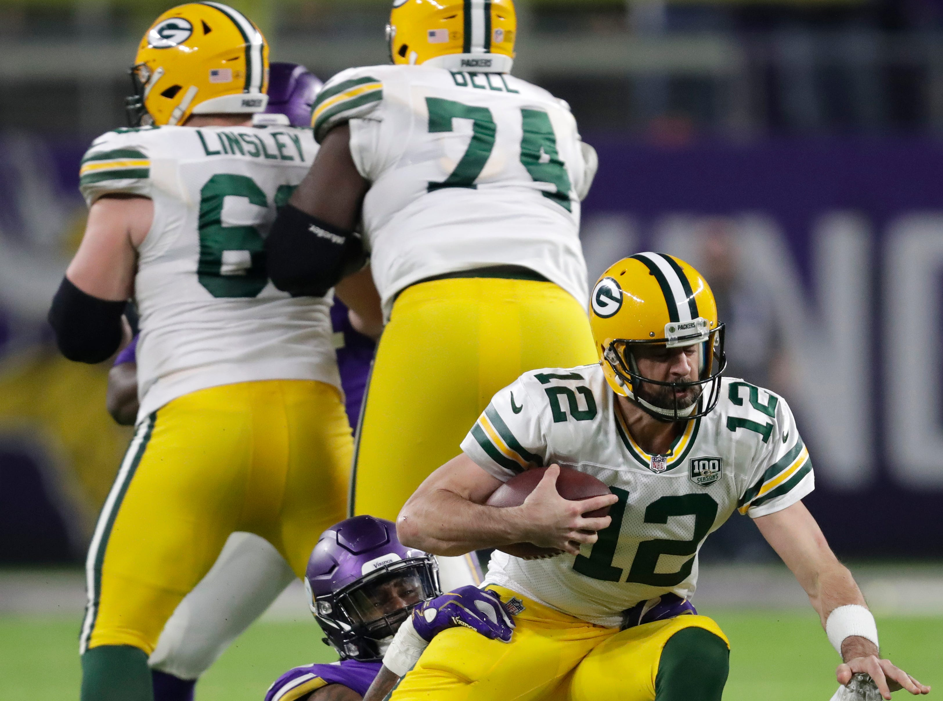 Green Bay Packers quarterback Aaron Rodgers (12) is sacked by Minnesota Vikings defensive tackle Sheldon Richardson (93) in the third quarter during their football game Sunday, November 25, 2018, at U.S. Bank Stadium in Minneapolis, Minn. 