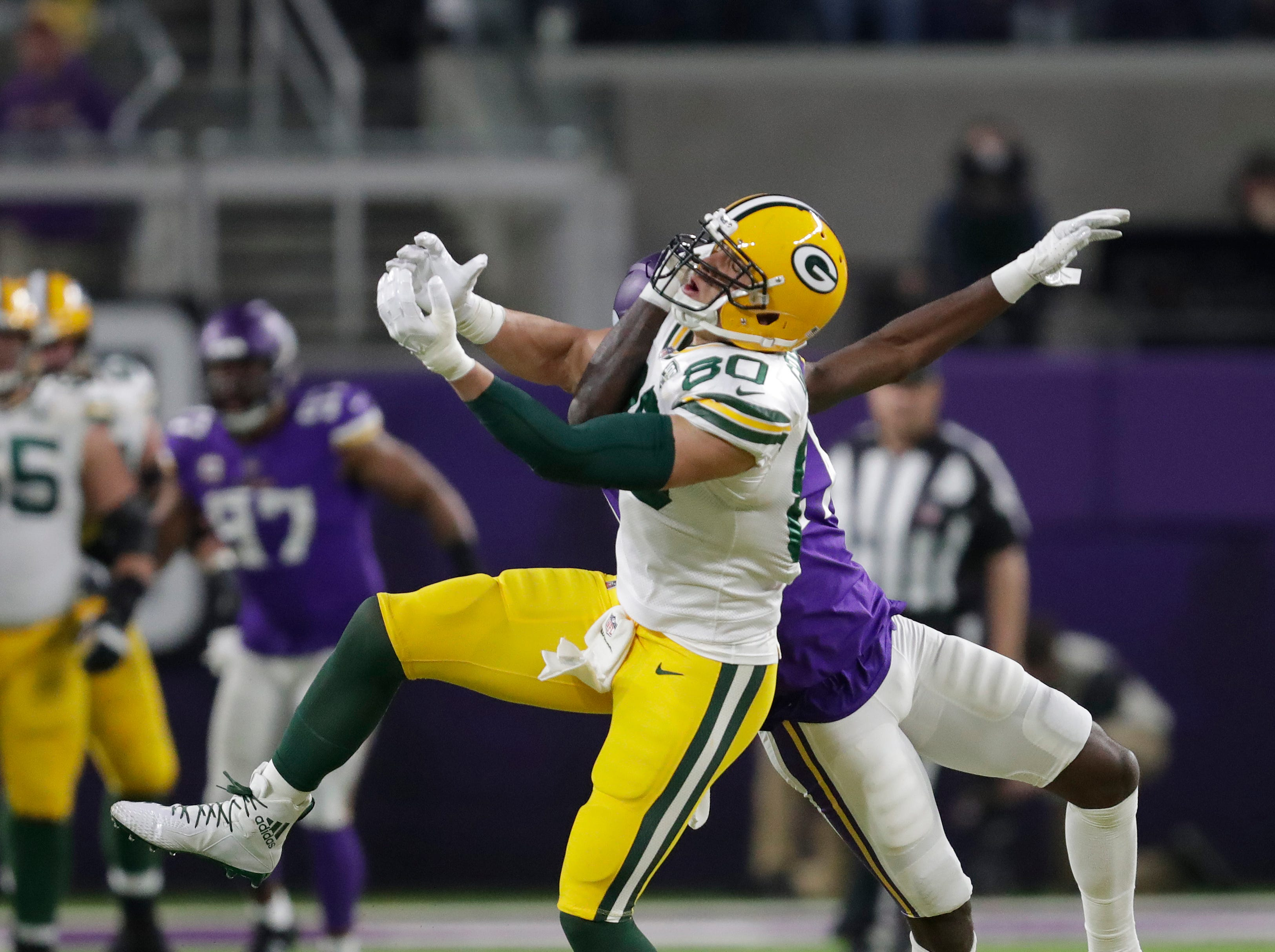 Green Bay Packers tight end Jimmy Graham (80) can't make the catch against Minnesota Vikings' Jayron Kearse (27) in the first half during their football game Sunday, November 25, 2018, at U.S. Bank Stadium in Minneapolis, Minn. 