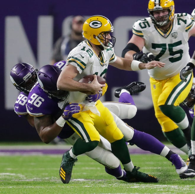 Green Bay Packers quarterback Aaron Rodgers (12) is brought down by Minnesota Vikings defensive end Danielle Hunter (99) and defensive tackle Tom Johnson (96) in the second quarter during their football game Sunday, November 25, 2018, at U.S. Bank Stadium in Minneapolis, Minn. Dan Powers/USA TODAY NETWORK-Wisconsin