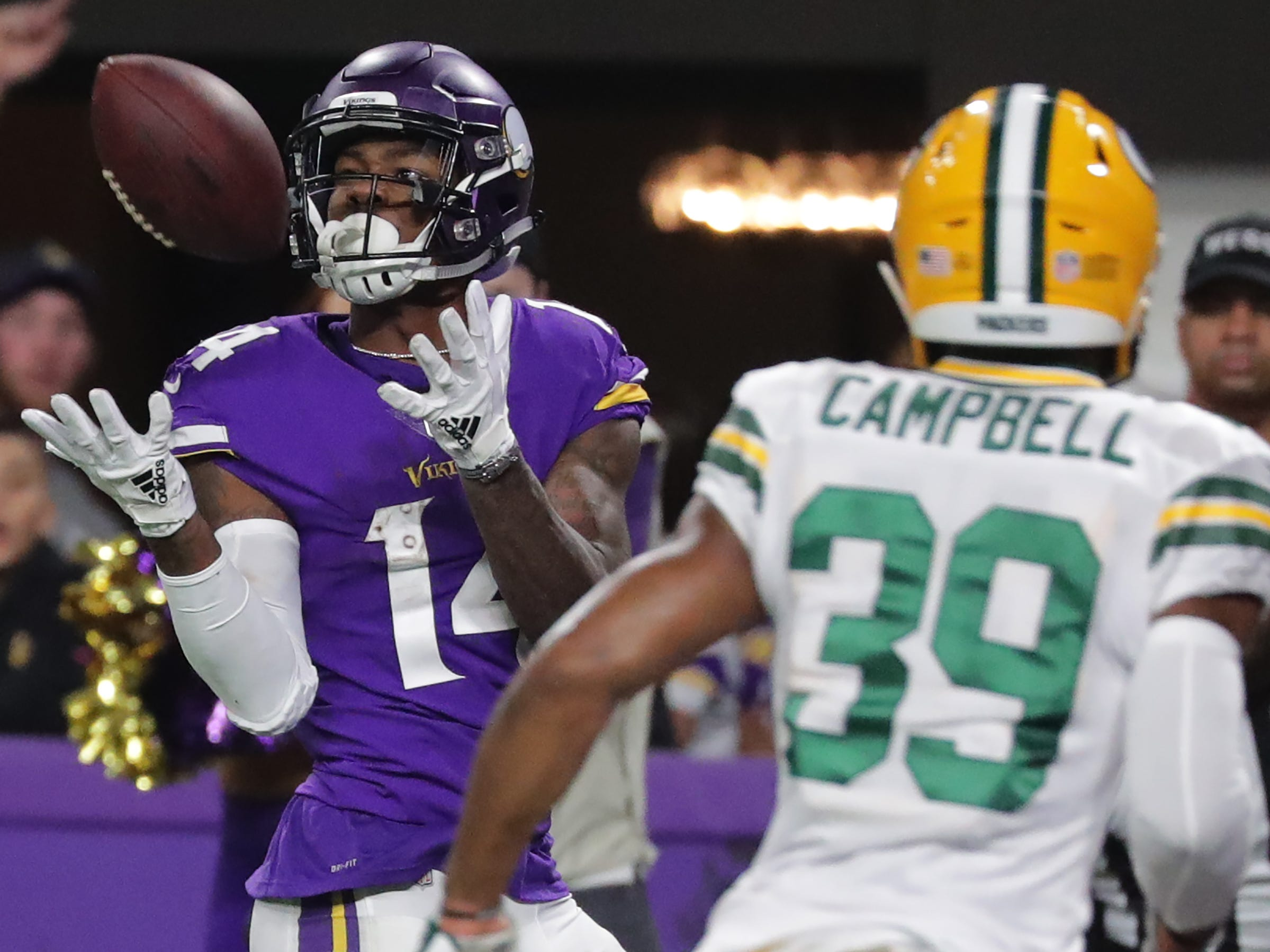 Minnesota Vikings wide receiver Stefon Diggs (14) makes a  30-yard touchdown reception during the second quarter of their game against the Green Bay Packers Sunday, November 25, 2018 at U.S. Bank Stadium in Minneapolis, Minn.