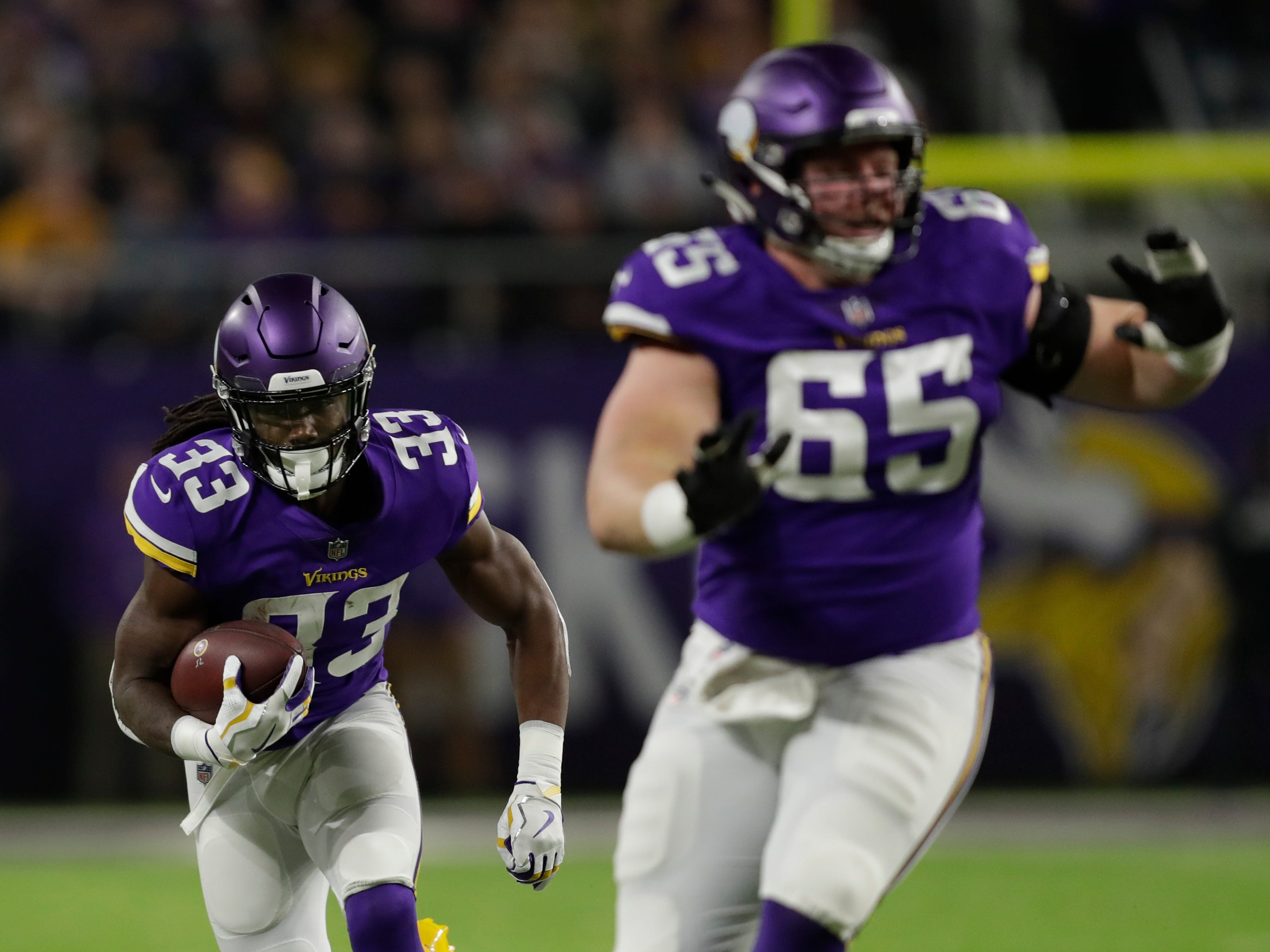 Minnesota Vikings running back Dalvin Cook (33) breaks away for a first quarter against the Green Bay Packers during their football game Sunday, November 25, 2018, at U.S. Bank Stadium in Minneapolis, Minn. 