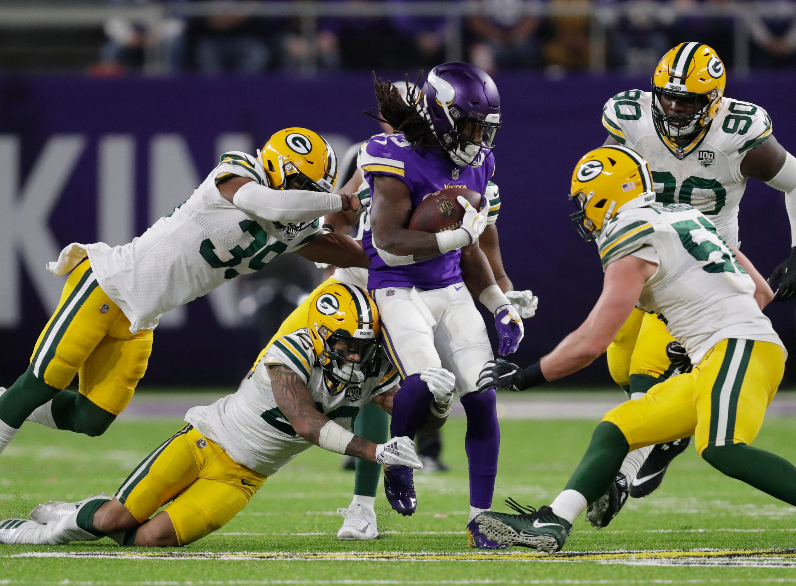 Minnesota Vikings running back Dalvin Cook (33) gainst yardage against the Packers defense in the third quarter during their football game Sunday, November 25, 2018, at U.S. Bank Stadium in Minneapolis, Minn. 