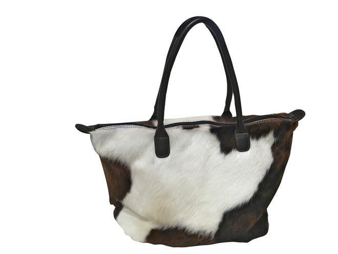 MooMoo Designs bag, $395, Mainly Shoes.