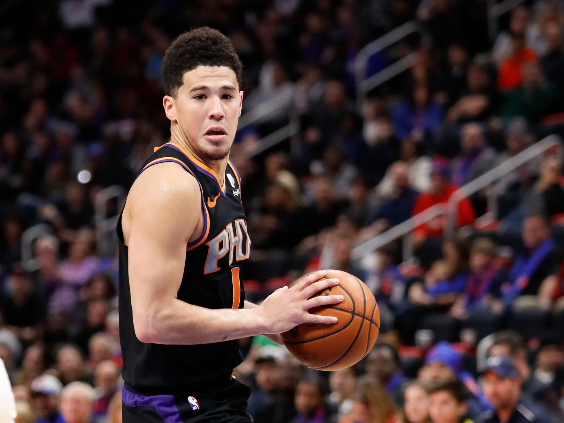 Nov 25, 2018; Detroit, MI, USA; Phoenix Suns guard Devin Booker (1) dribbles the ball during the fourth quarter against the Detroit Pistons at Little Caesars Arena. Mandatory Credit: Raj Mehta-USA TODAY Sports