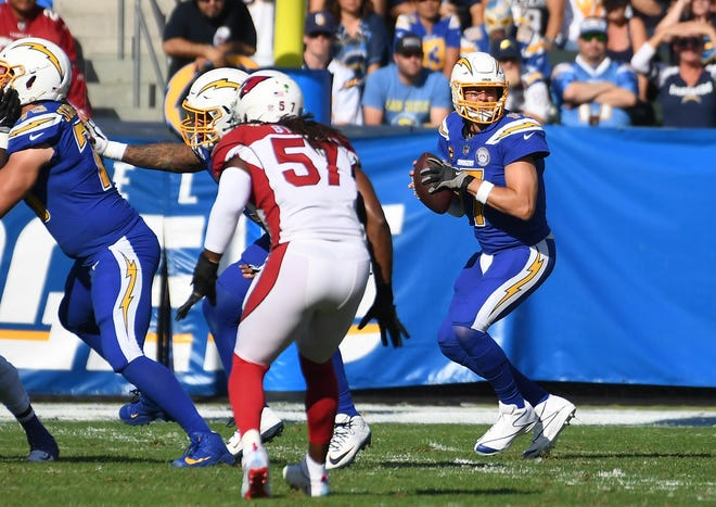 Nov 25, 2018: Los Angeles Chargers quarterback Philip Rivers (17) drops back to pass against the Arizona Cardinals in the first half at the StubHub Center.