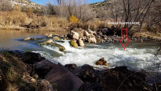 The area in the Verde River where a woman who was trapped between two boulders was rescued.