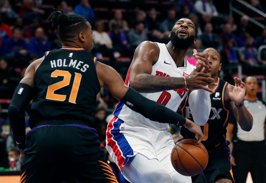 Phoenix Suns forward Richaun Holmes (21) strips the ball away from Detroit Pistons center Andre Drummond (0) during the first half of an NBA basketball game, Sunday, Nov. 25, 2018, in Detroit. (AP Photo/Carlos Osorio)