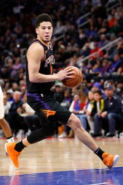 Suns guard Devin Booker had 37 points against the Pistons in a loss 118-107 on Sunday in Detroit.