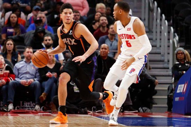 Nov 25, 2018; Detroit, MI, USA; Phoenix Suns guard Devin Booker (1) dribbles the ball against Detroit Pistons guard Bruce Brown (6) during the third quarter at Little Caesars Arena. Mandatory Credit: Raj Mehta-USA TODAY Sports