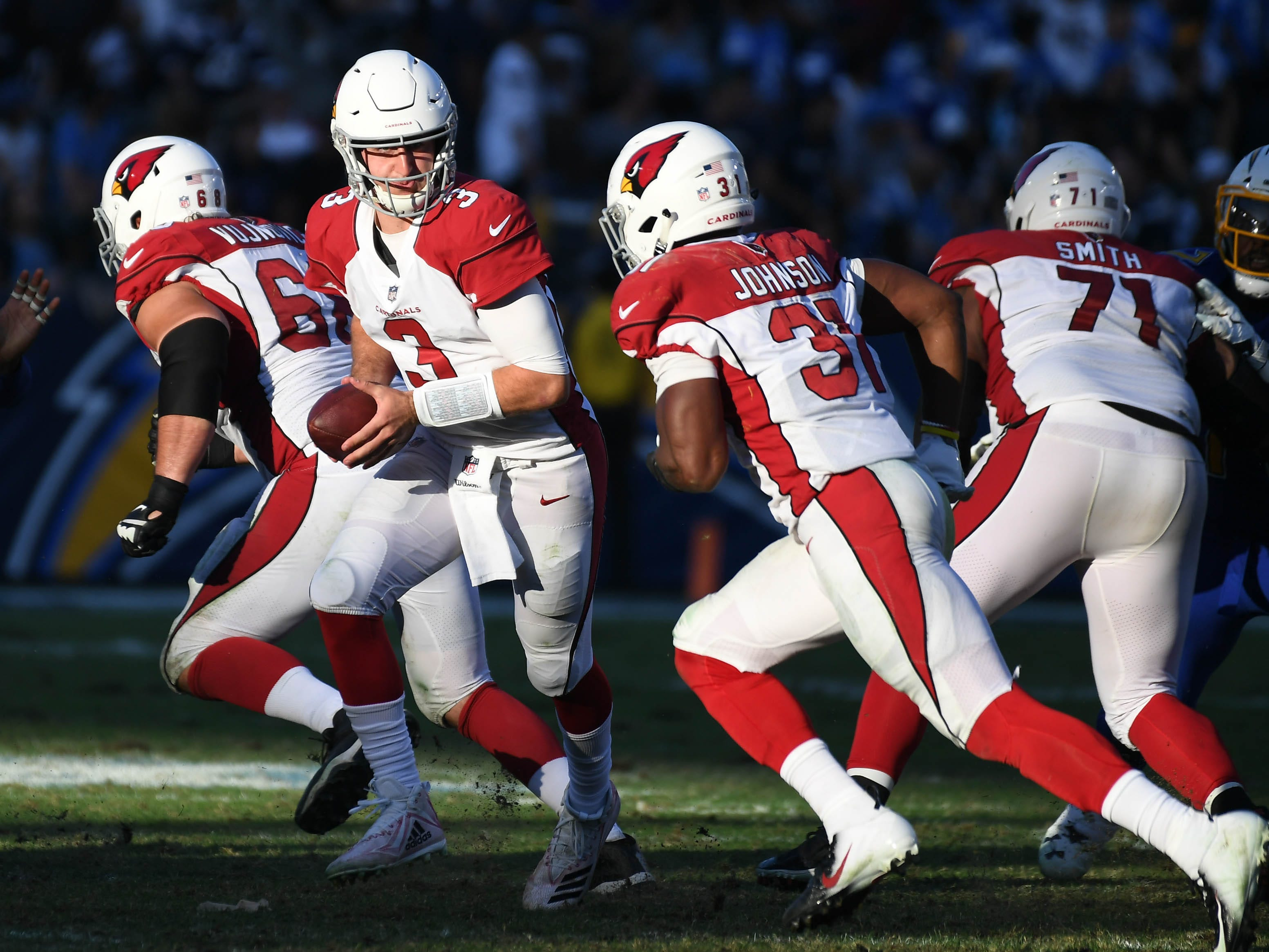 Nov 25, 2018; Carson, CA, USA; Arizona Cardinals quarterback Josh Rosen (3) hands the ball to running back David Johnson (31) against the Los Angeles Chargers in the second half at the StubHub Center.