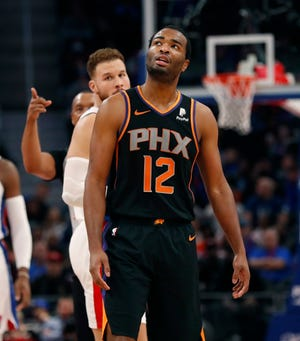 Phoenix Suns forward T.J. Warren (12) looks toward the scoreboard after a second technical foul during the first half of an NBA basketball game against the Detroit Pistons, Sunday, Nov. 25, 2018, in Detroit. Warren fouled out of the game.