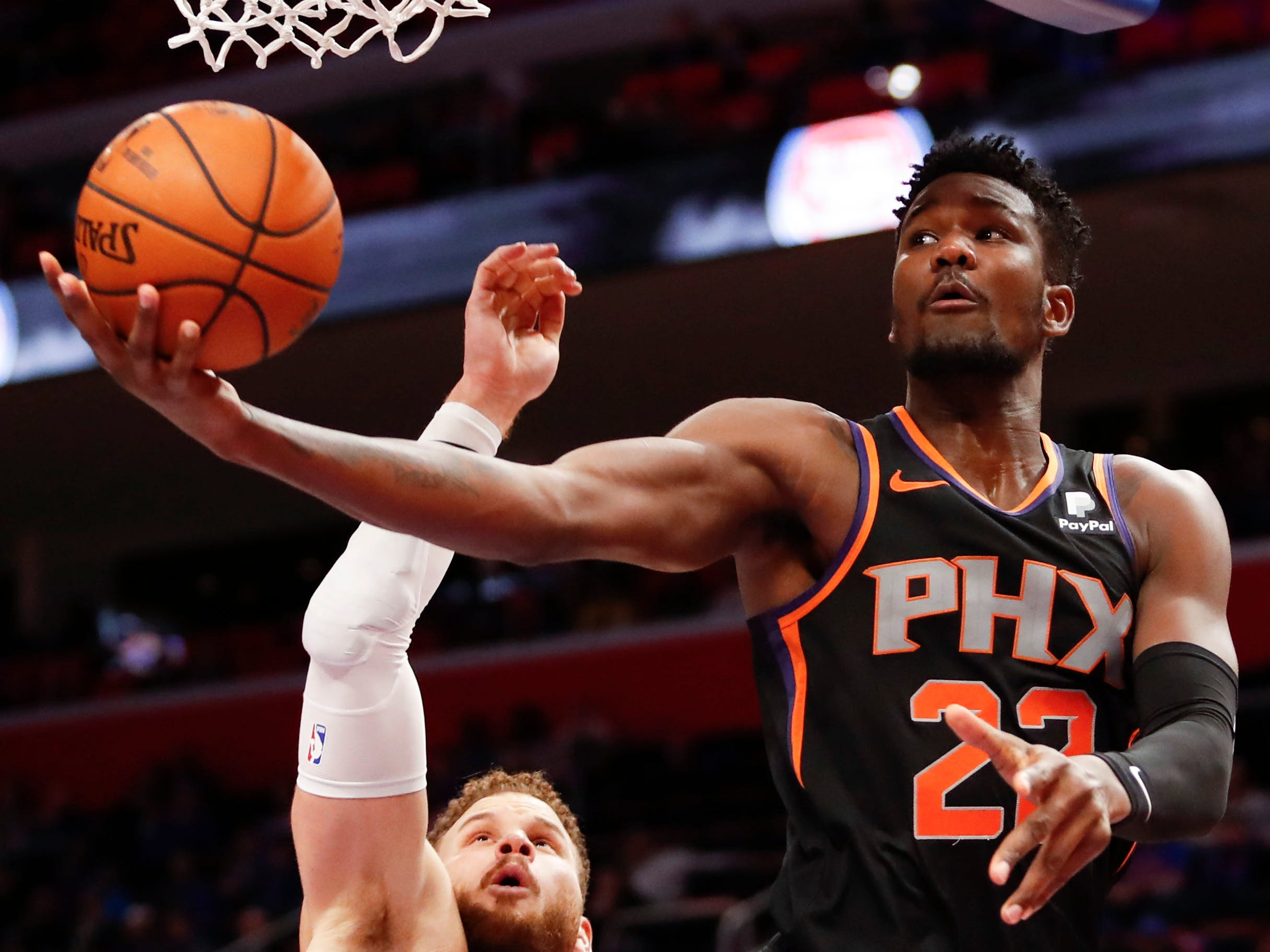 Nov 25, 2018; Detroit, MI, USA; Phoenix Suns center Deandre Ayton (22) goes up for a shot against Detroit Pistons forward Blake Griffin (23) during the fourth quarter at Little Caesars Arena. Mandatory Credit: Raj Mehta-USA TODAY Sports