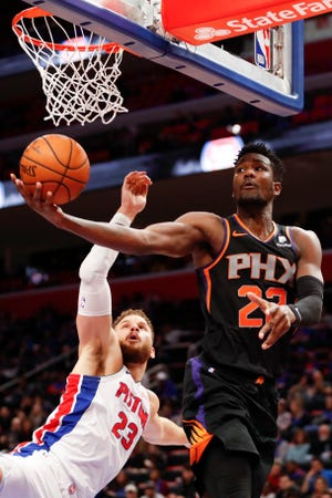 Suns center Deandre Ayton goes up for a shot against Pistons forward Blake Griffin during the fourth quarter of a game at Little Caesars Arena.