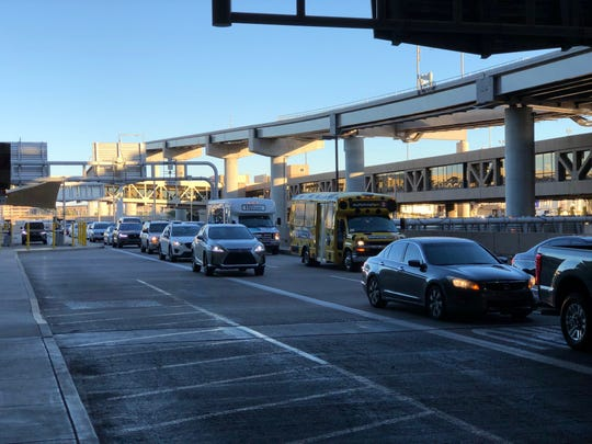 A line of cars is seen outside of Sky Harbor Airport's Terminal 4 on Sunday.