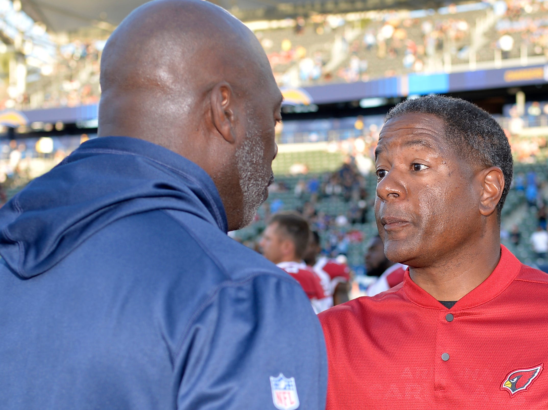 Nov 25, 2018; Carson, CA, USA; Arizona Cardinals head coach Steve Wilks (right) and Los Angeles Chargers head coach Anthony Lynn talk  after the game at StubHub Center.