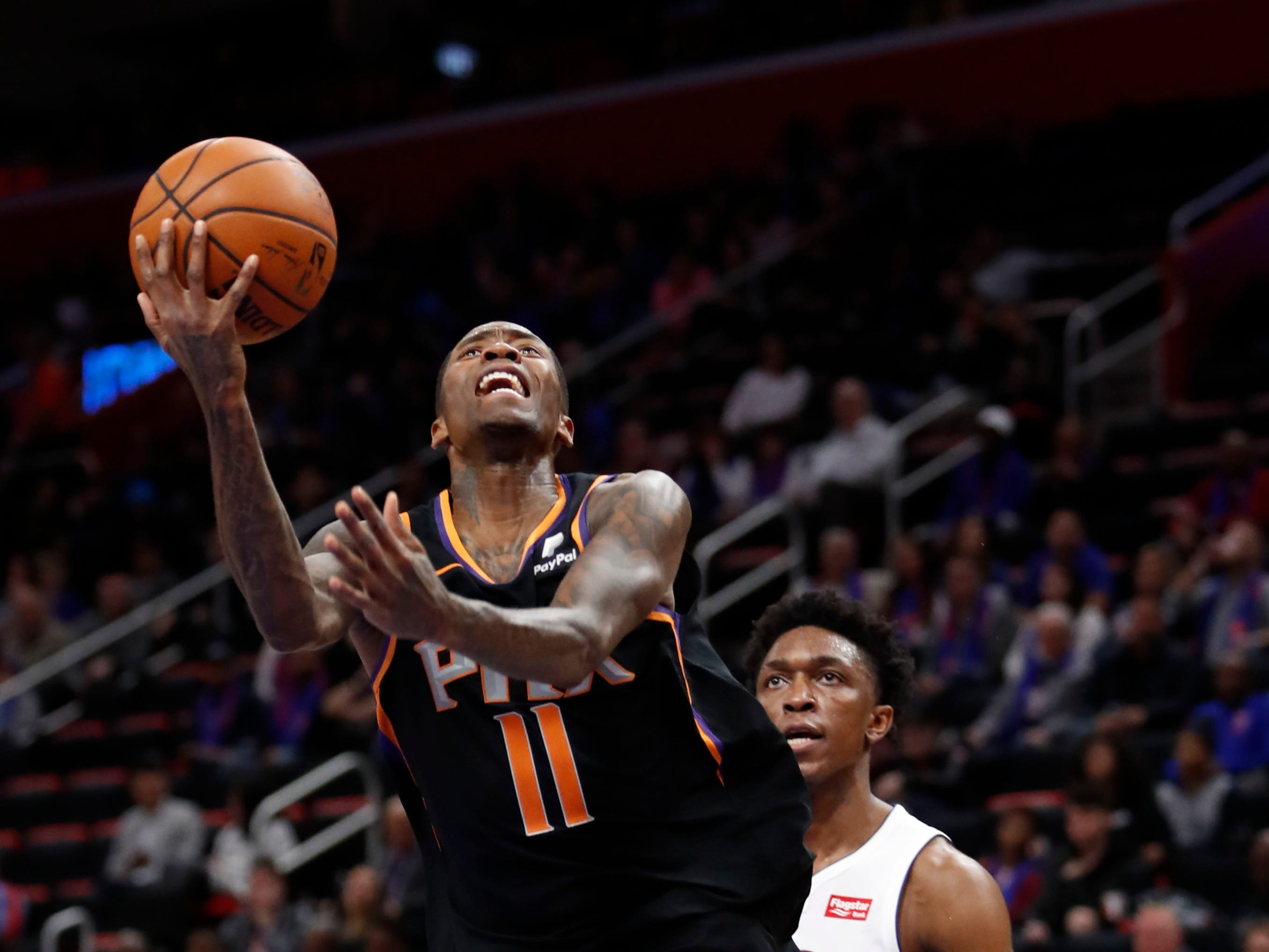 Nov 25, 2018; Detroit, MI, USA; Phoenix Suns guard Jamal Crawford (11) goes up for a shot against Detroit Pistons forward Stanley Johnson (7) during the fourth quarter at Little Caesars Arena. Mandatory Credit: Raj Mehta-USA TODAY Sports