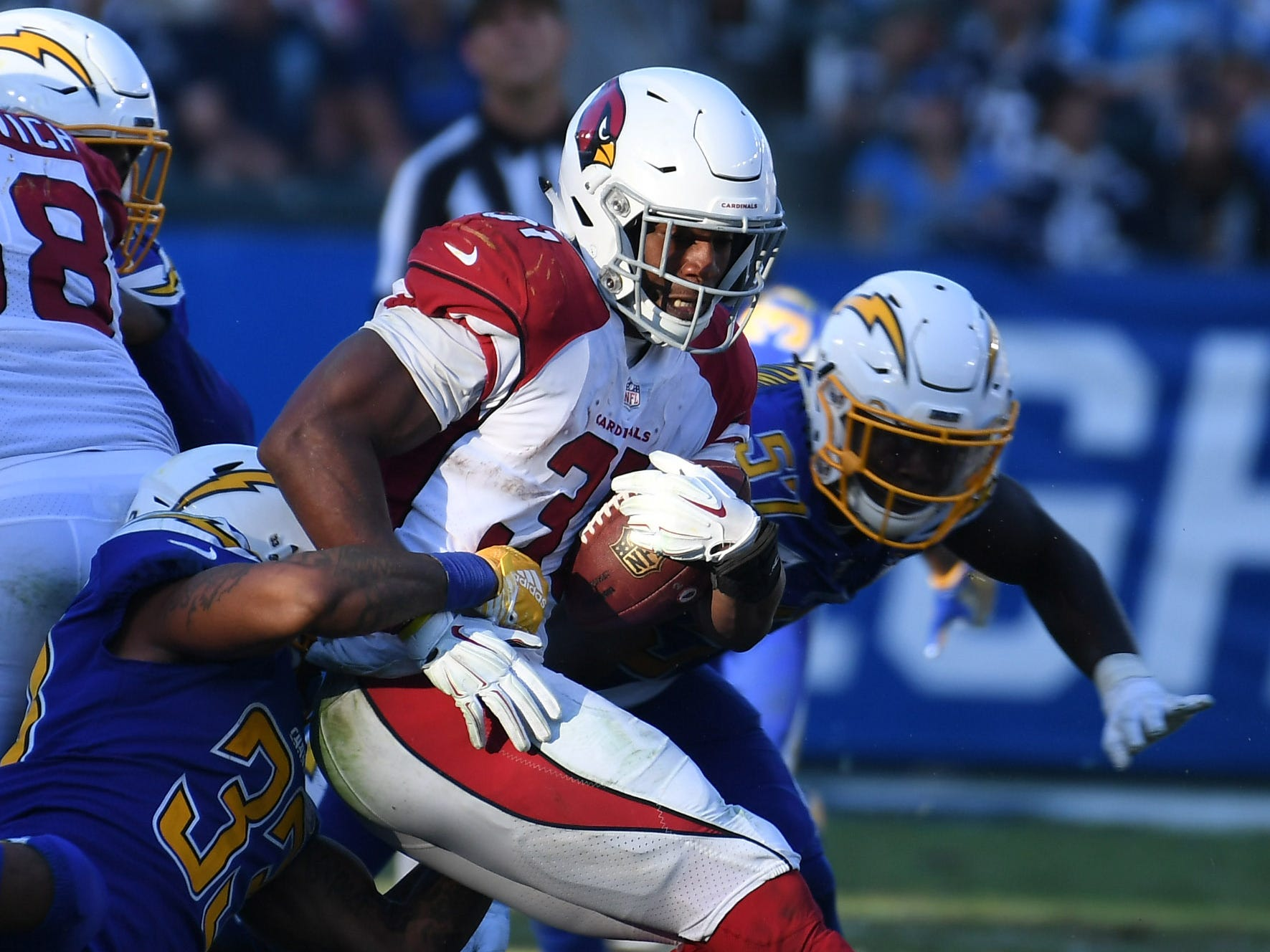Nov 25, 2018; Carson, CA, USA; Arizona Cardinals running back David Johnson (31) is tackled by Los Angeles Chargers free safety Derwin James (33) in the second half at the StubHub Center.
