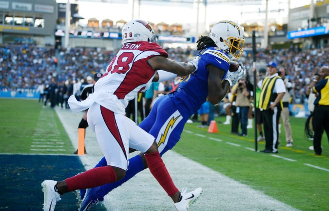Los Angeles Chargers wide receiver Mike Williams, right, makes a touchdown catch next to Arizona Cardinals defensive back David Amerson during the first half of an NFL football game Sunday, Nov. 25, 2018, in Carson, Calif.