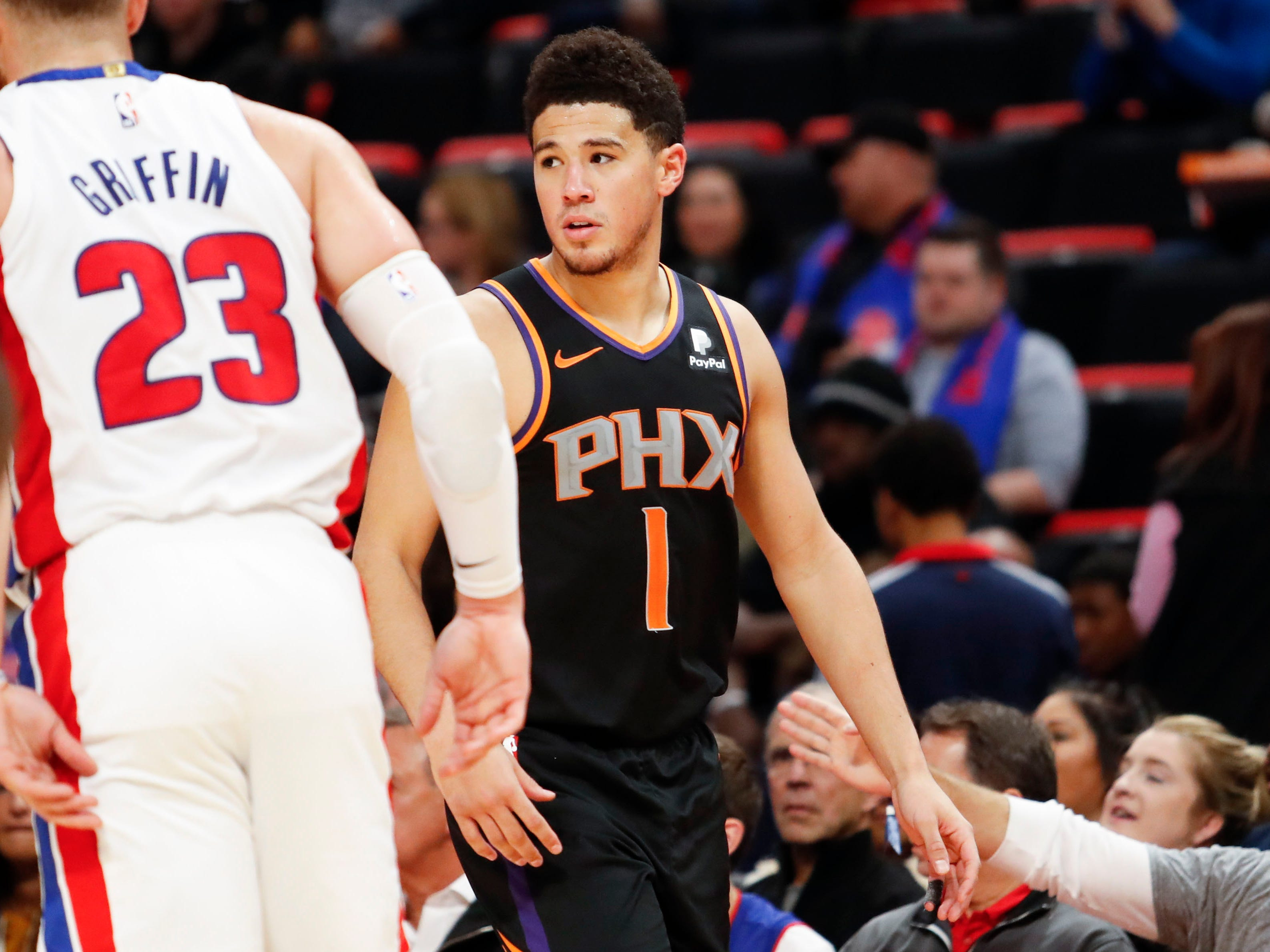 Nov 25, 2018; Detroit, MI, USA; Phoenix Suns guard Devin Booker (1) looks on during the fourth quarter against the Detroit Pistons at Little Caesars Arena. Mandatory Credit: Raj Mehta-USA TODAY Sports