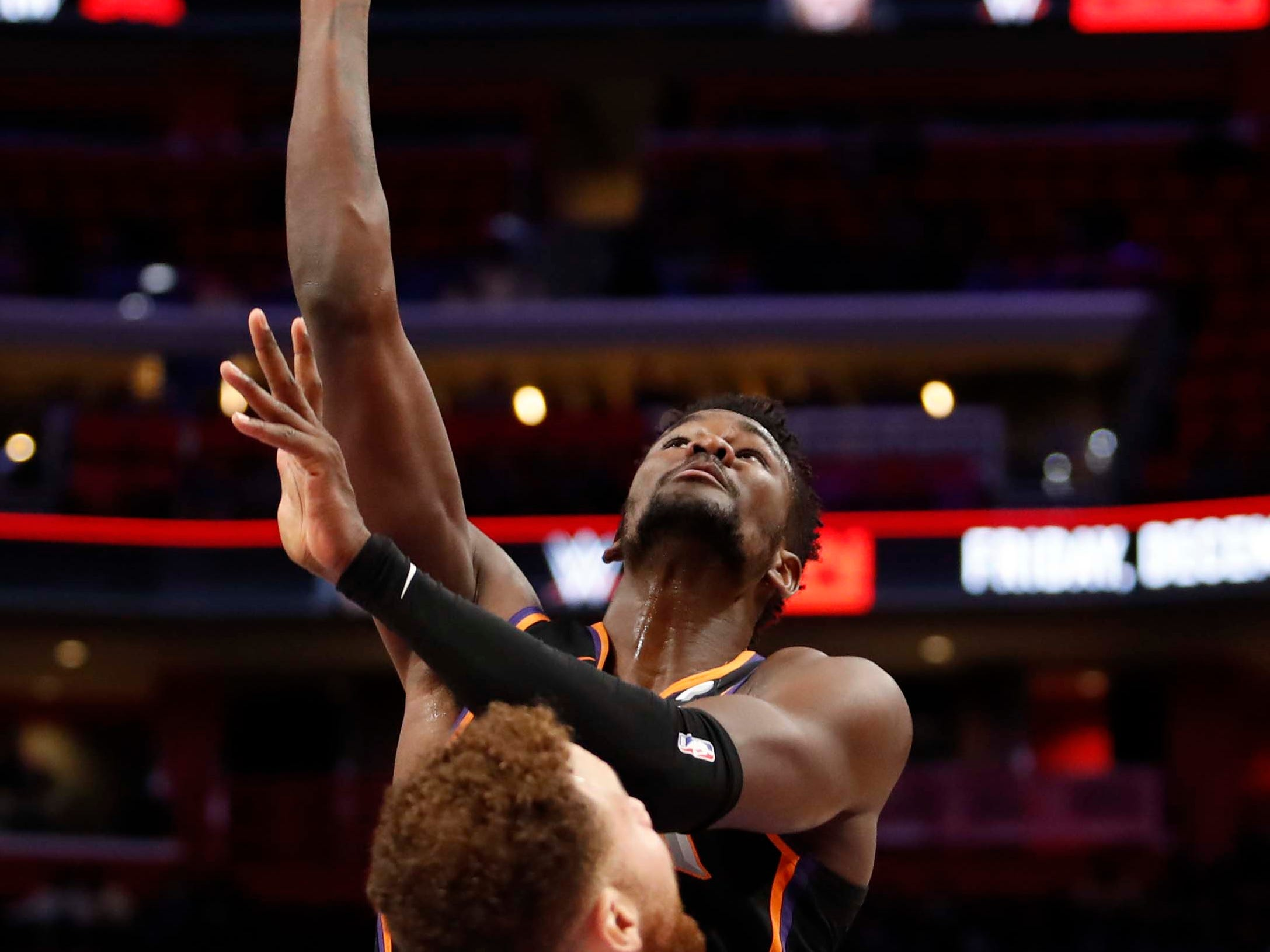 Nov 25, 2018; Detroit, MI, USA; Phoenix Suns center Deandre Ayton (22) takes a shot against Detroit Pistons forward Blake Griffin (23) during the third quarter at Little Caesars Arena. Mandatory Credit: Raj Mehta-USA TODAY Sports