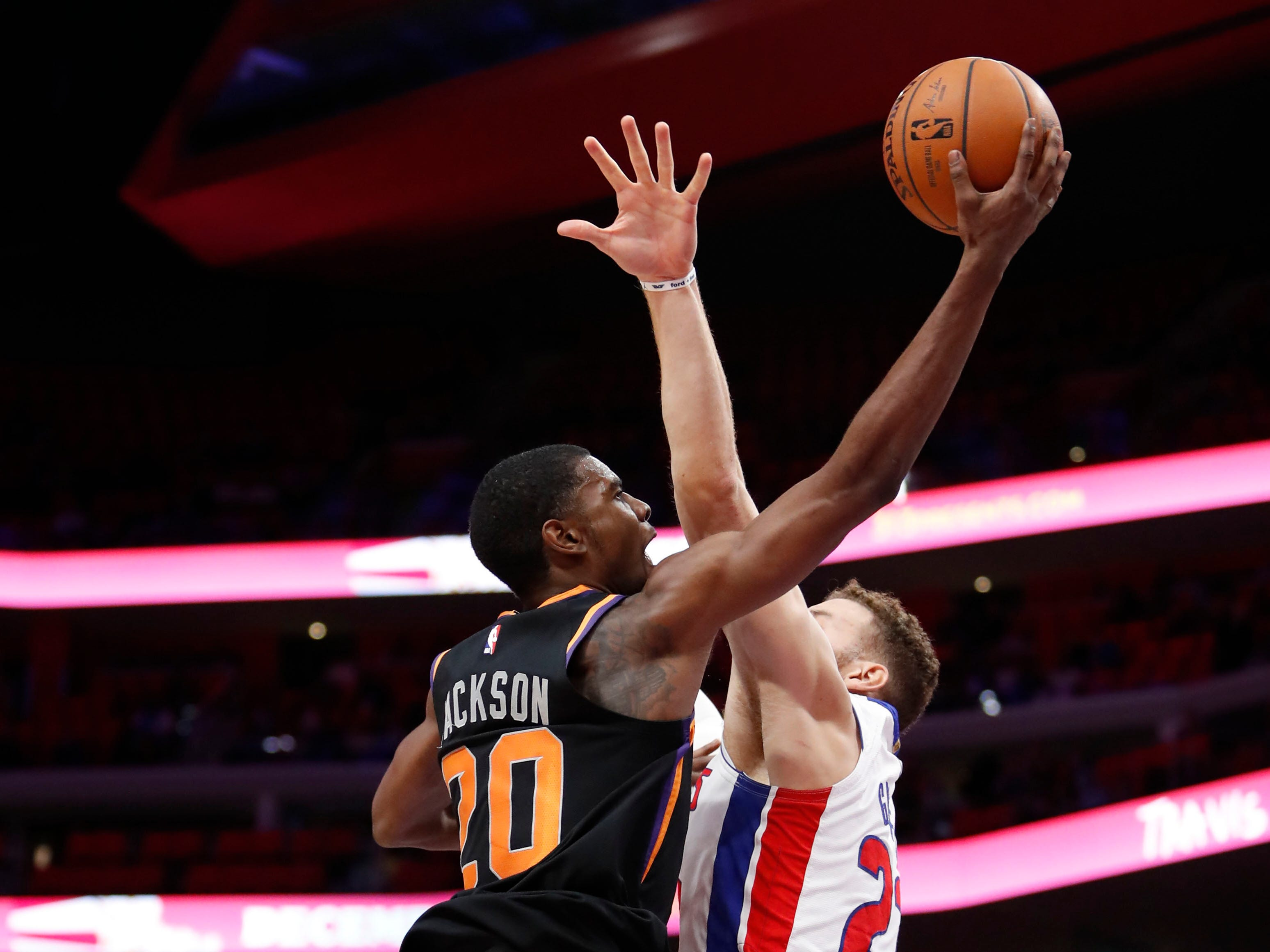 Nov 25, 2018; Detroit, MI, USA; Phoenix Suns forward Josh Jackson (20) goes up for a shot against Detroit Pistons forward Blake Griffin (23) during the fourth quarter at Little Caesars Arena. Mandatory Credit: Raj Mehta-USA TODAY Sports