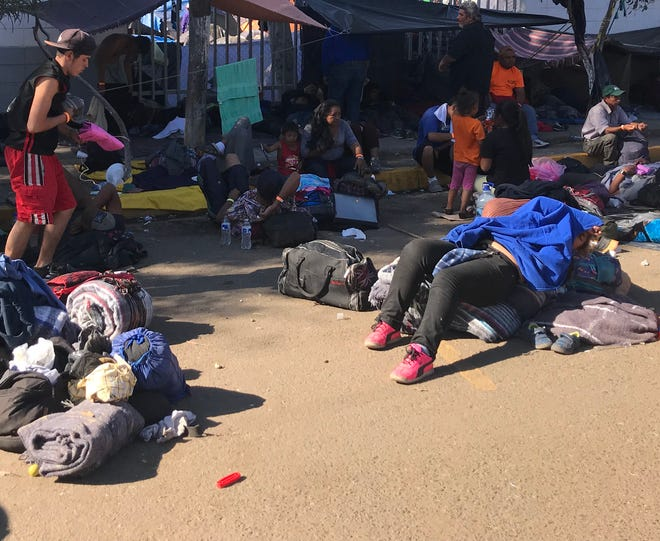 Conditions at the makeshift shelter are so crowded, families are now camping outside the  sports park.
