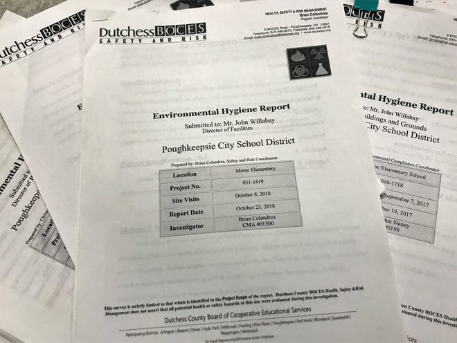 A stack of environmental hygiene reports from air quality investigations conducted in the Poughkeepsie City School District,