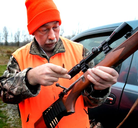 Robert Livengood, of Dover, loads his .30-caliber rifle before hunting with his son Owen, 12, at a State Game Land near New Salem on the first day of regular firearm season on Monday, Nov. 26, 2018. The overall 2018-19 Pennsylvania deer harvest was the highest in 14 years. The overall buck harvest, however, was down 10 percent.