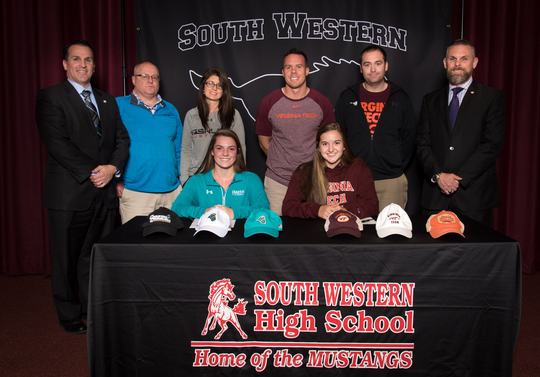 South Western seniors Jordan Gertz and Taylor Geiman sign their national letters of intent. Gertz, front row left, is headed to Coastal Carolina to play lacrosse. Geiman, front row right, is headed to Virginia Tech to play basketball.